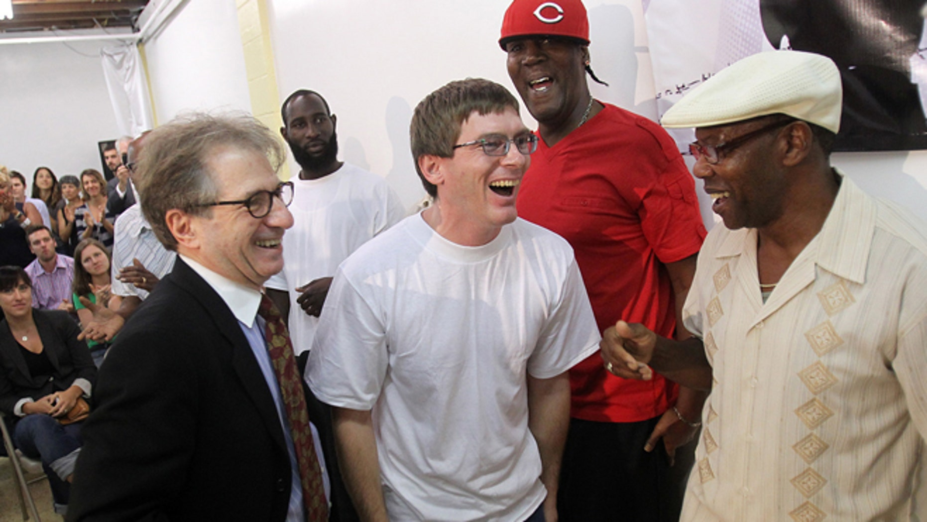 Sept 28: With attorney Barry Scheck, left, founder of the Innocence Project, at his side,  Damon Thibodeaux shares a laugh with previously exonerated men Derrick James, second from right, and Ricky Johnson  upon arrival at a press conference.