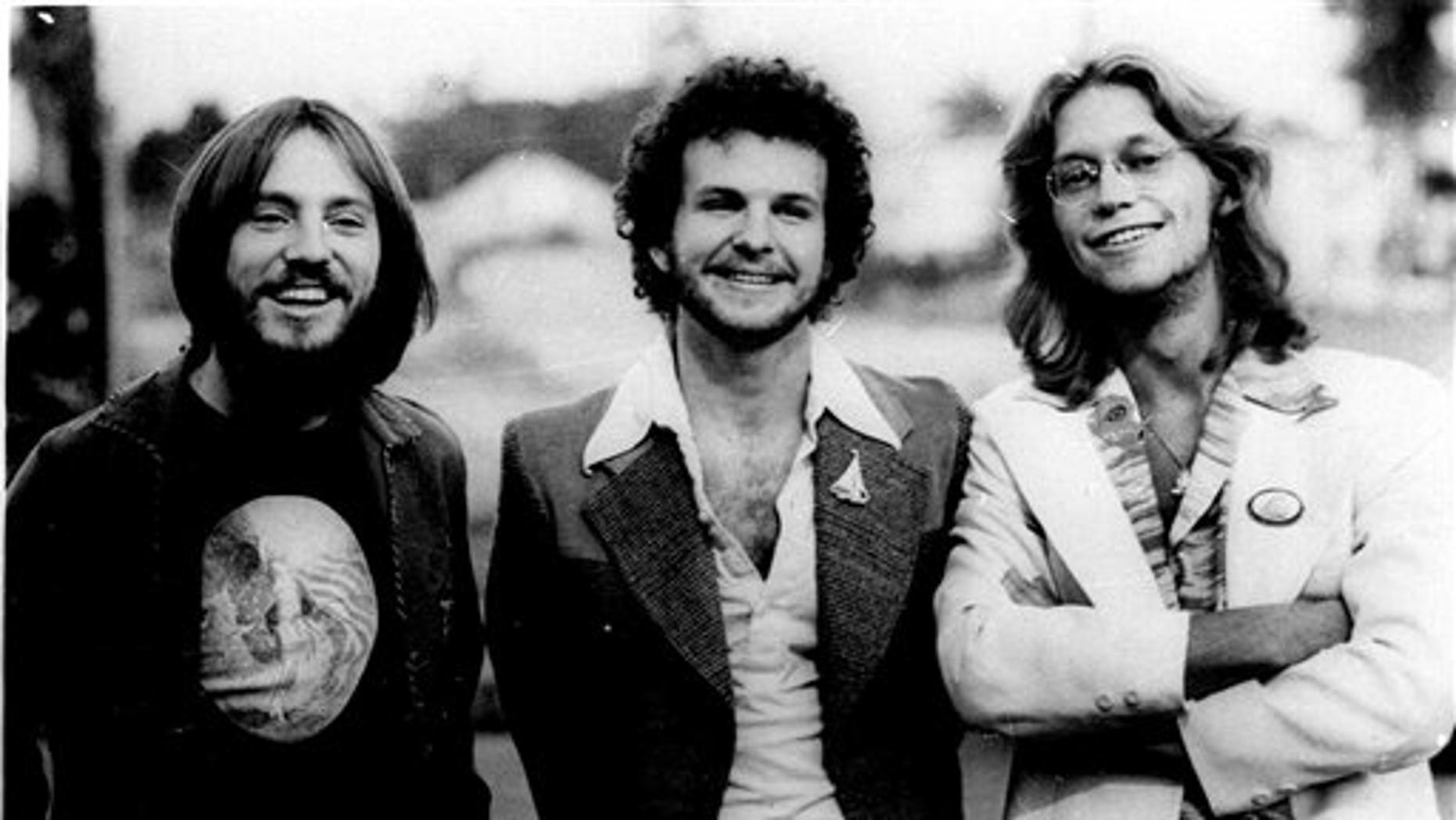 """The rock group """"America"""" is shown in this photo dated 1976. Members of the group, shown from left are: Dewey Bunnel, Dan Peek, and Gerry Beckley. Peek, a founding member of the popular 1970s band America and singer of high harmonies on hits that included """"A Horse With No Name"""" and """"Ventura Highway,"""" died Sunday in bed in his home in Farmington, Mo., his father said Tuesday, July 26, 2011. (AP)"""