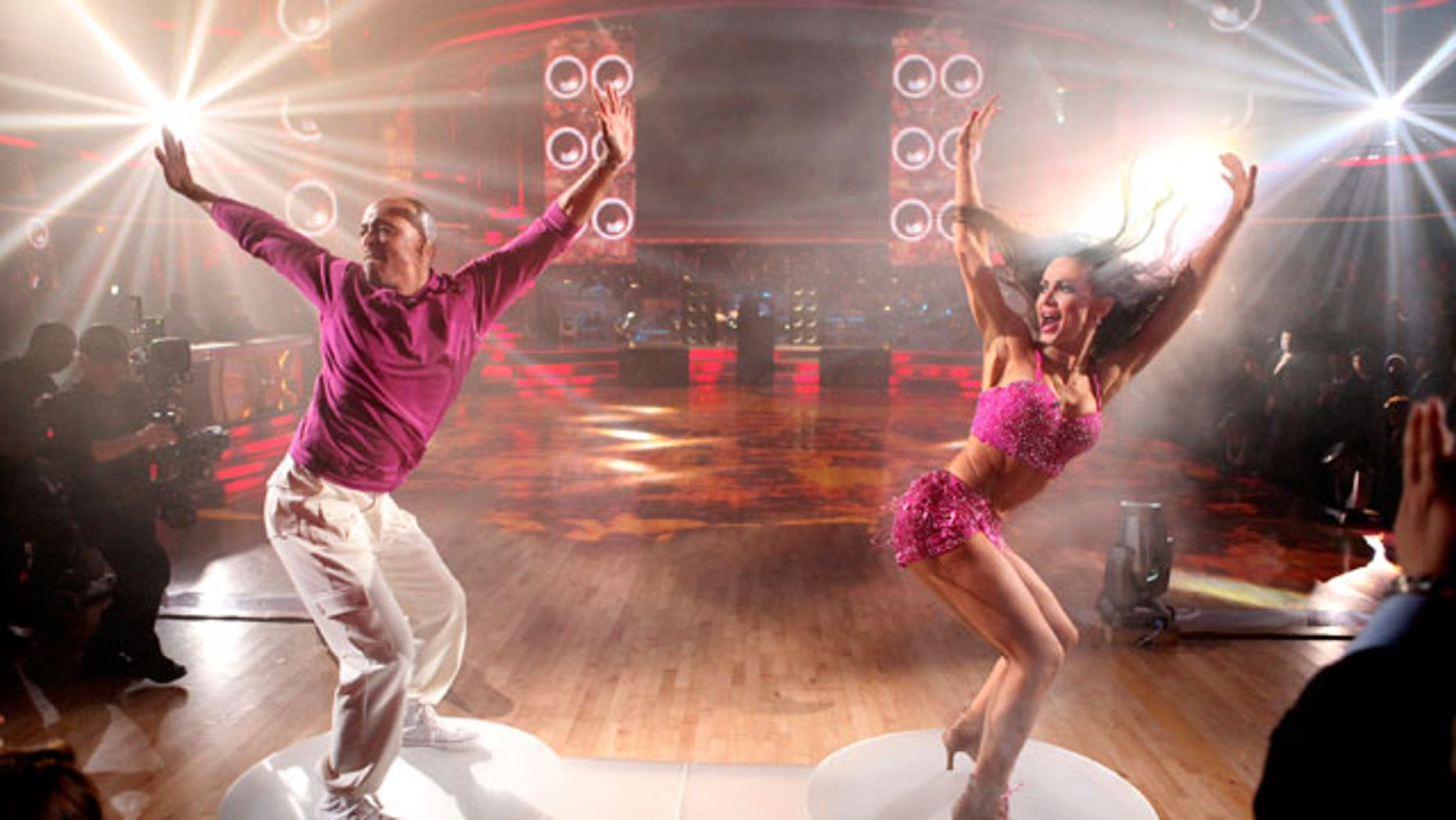 "In this Nov. 21, 2011 file photo released by ABC, J.R. Martinez, left, and his partner Karina Smirnoff perform on the celebrity dance competition series ""Dancing with the Stars,"" in Los Angeles."
