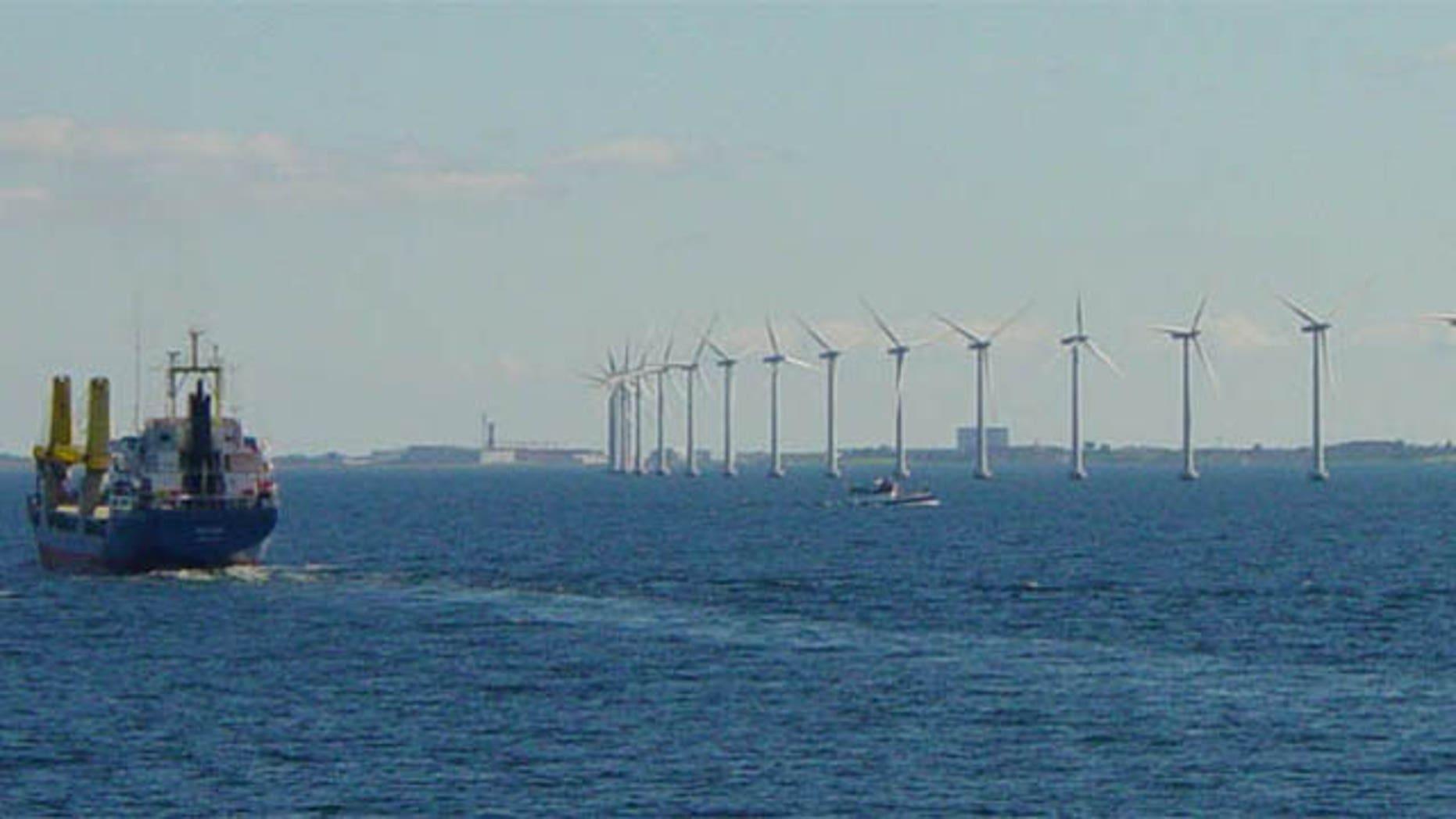 Danish wind turbines spin slowly off the coast of Copenhagen.