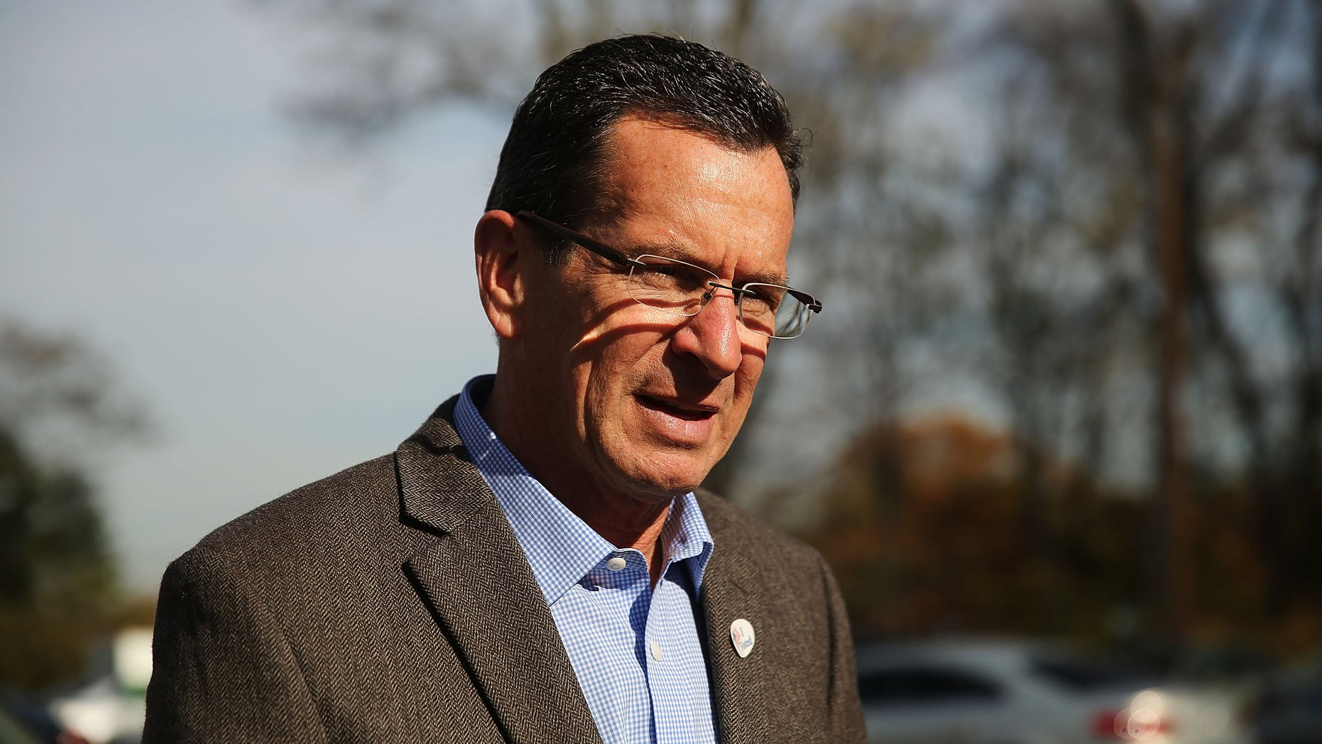 BRIDGEPORT, CT - NOVEMBER 04:  Democratic Connecticut Governor Dan Malloy stops at a polling station on November 4, 2014 in Bridgeport, Connecticut.  Around the country voters are turning out to decide the 2014 midterm elections. In Connecticut voters will decide on whether to keep Democratic Malloy who is currently in a dead heat with Republican Tom Foley. Polls show a tight race in many states with most analysts predicting that the Republicans are on track to make gains and possibly control the U.S. Senate.  (Photo by Spencer Platt/Getty Images)