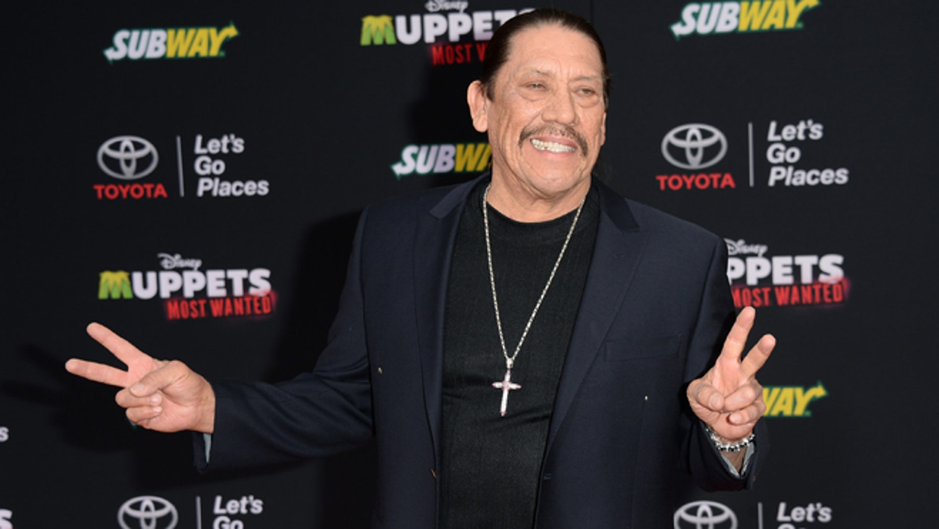 """HOLLYWOOD, CA - MARCH 11:  Actor Danny Trejo attends the premiere of Disney's """"Muppets Most Wanted"""" at the El Capitan Theatre on March 11, 2014 in Hollywood, California.  (Photo by Jason Merritt/Getty Images)"""