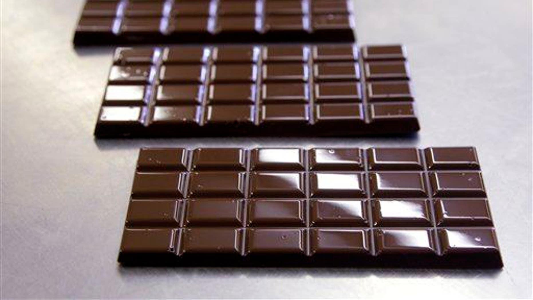 Dark chocolate bars are shown.