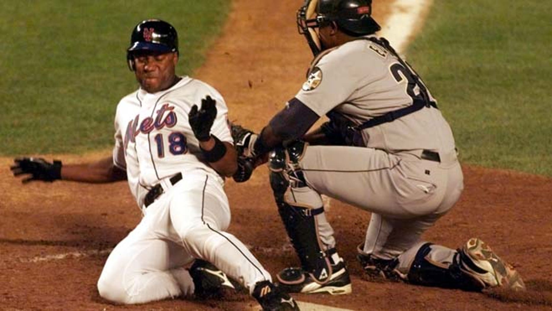 Aug. 23, 1999: New York Mets' runner Darryl Hamilton (L) is out at the plate on a tag by Houston Astros' catcher Tony Eusebio in the fourth inning at New York's Shea Stadium.