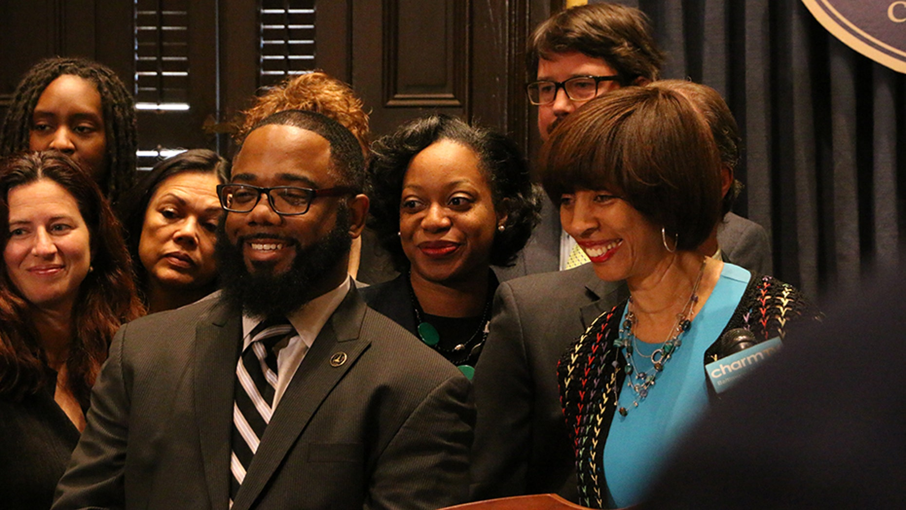 Darryl Strange, pictured with Baltimore Mayor Catherine Pugh, was a city police officer between 2006 and 2011.