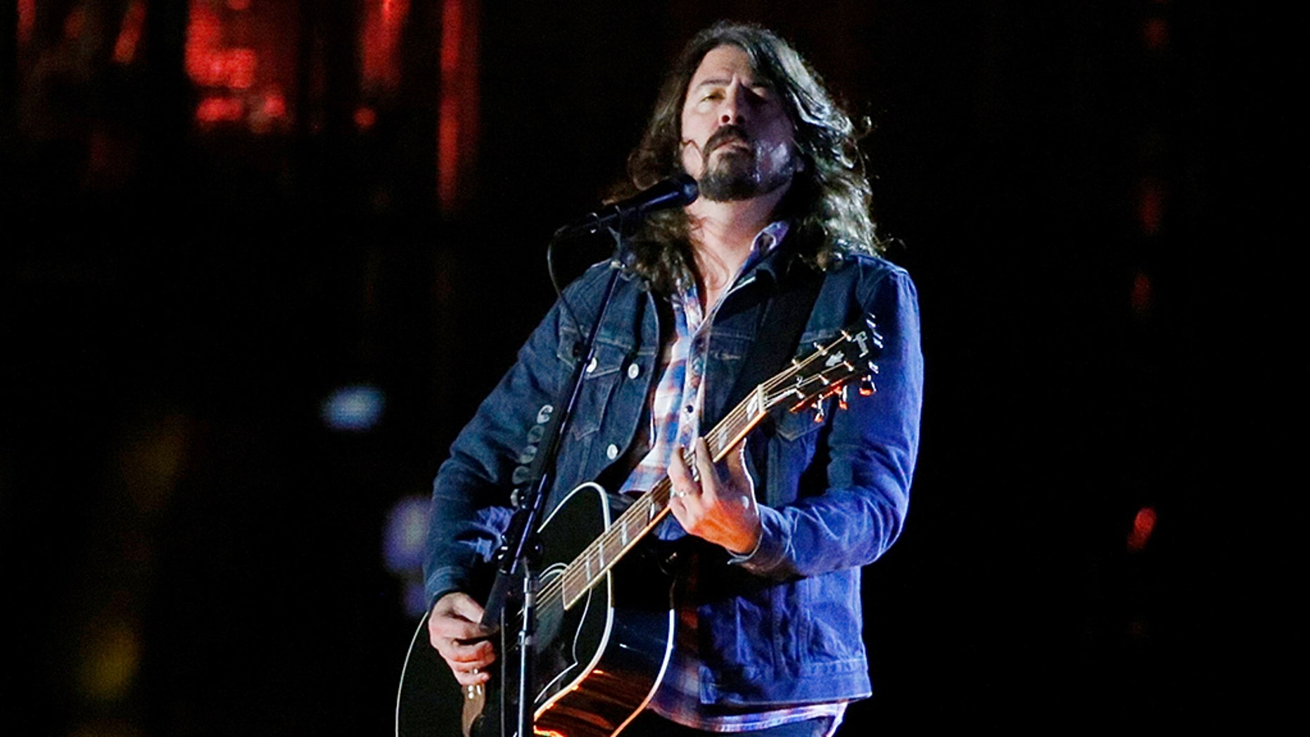 """Dave Grohl called President Trump a """"massive jerk"""" and said he was """"ashamed"""" of him."""