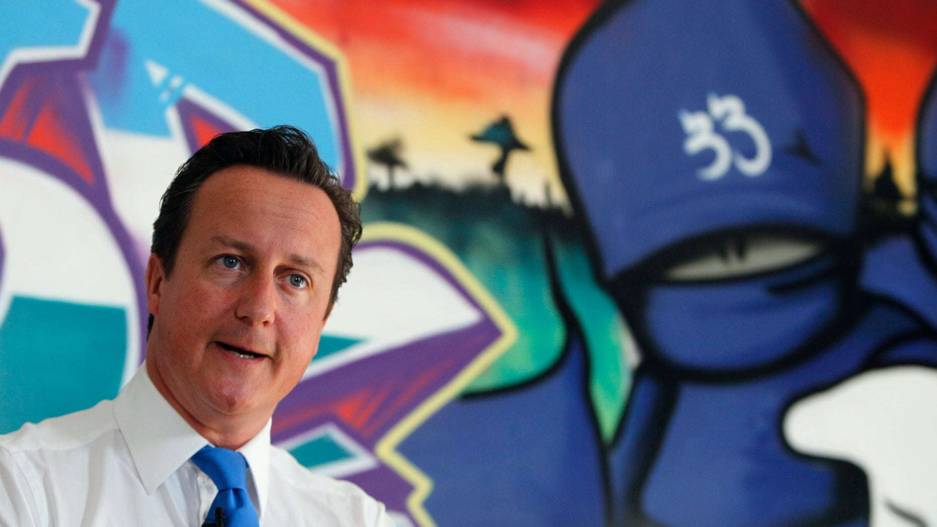 """August 15: Britain's Prime Minister David Cameron speaks at a youth center in Witney, his Parliamentary district in southern England. Britain must confront its """"slow-motion moral collapse"""" Cameron declared following four days of riots that left five people dead, thousands facing criminal charges and at least 200 million pounds ($326 million) in property losses."""