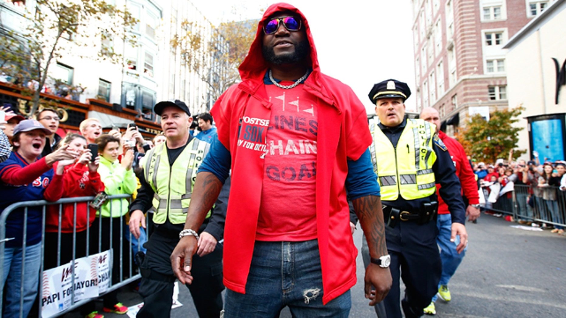BOSTON, MA - NOVEMBER 02: David Ortiz #34 of the Boston Red Sox walks down Boylston Street near the finish line of the Boston Marathon during the World Series victory parade on November 2, 2013 in Boston, Massachusetts.  (Photo by Jared Wickerham/Getty Images)