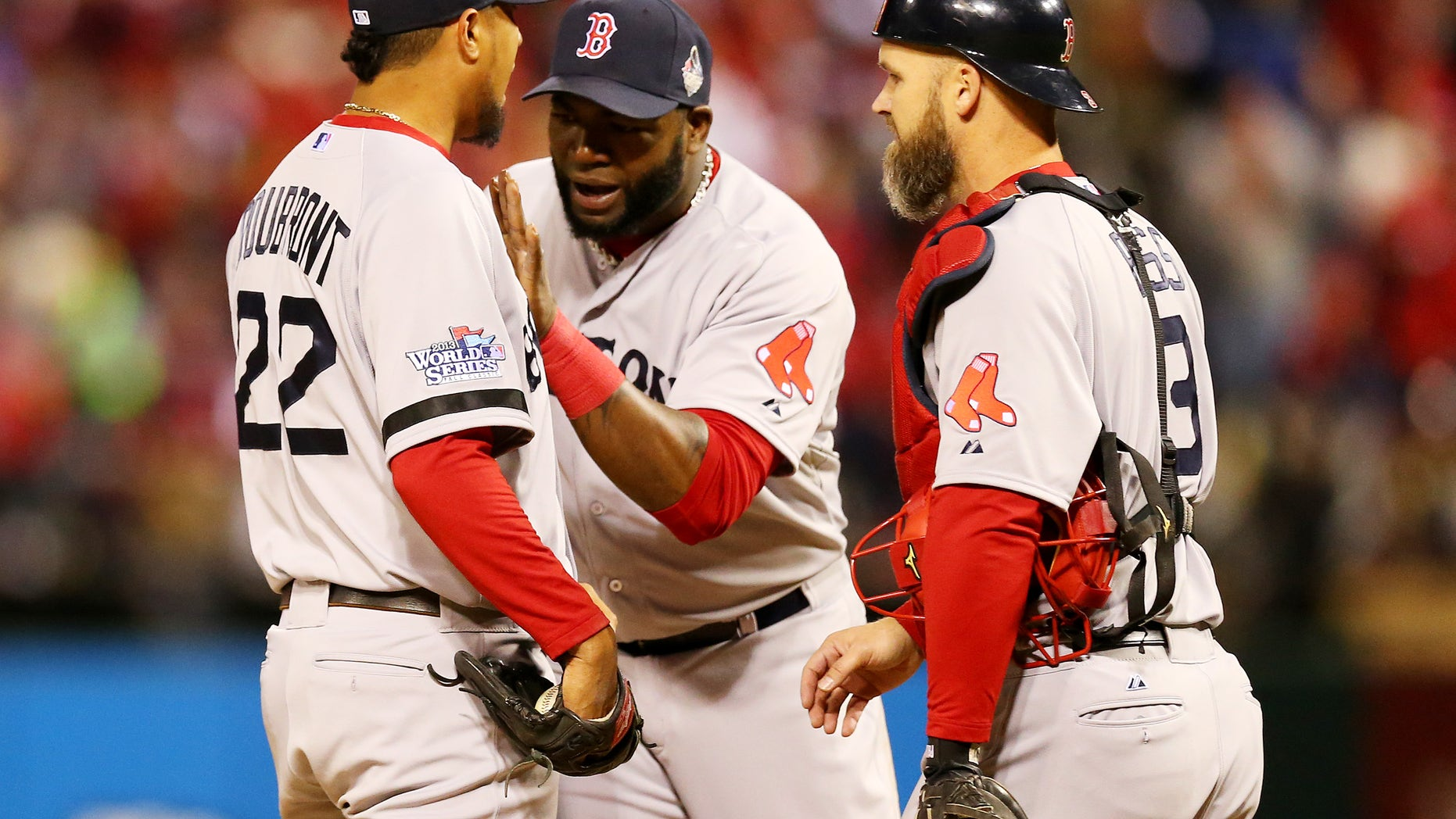 ST LOUIS, MO - OCTOBER 27:  David Ortiz #34 and David Ross #3 of the Boston Red Sox talk with pitcher Felix Doubront #22 against the St. Louis Cardinals during Game Four of the 2013 World Series at Busch Stadium on October 27, 2013 in St Louis, Missouri.  (Photo by Ronald Martinez/Getty Images)