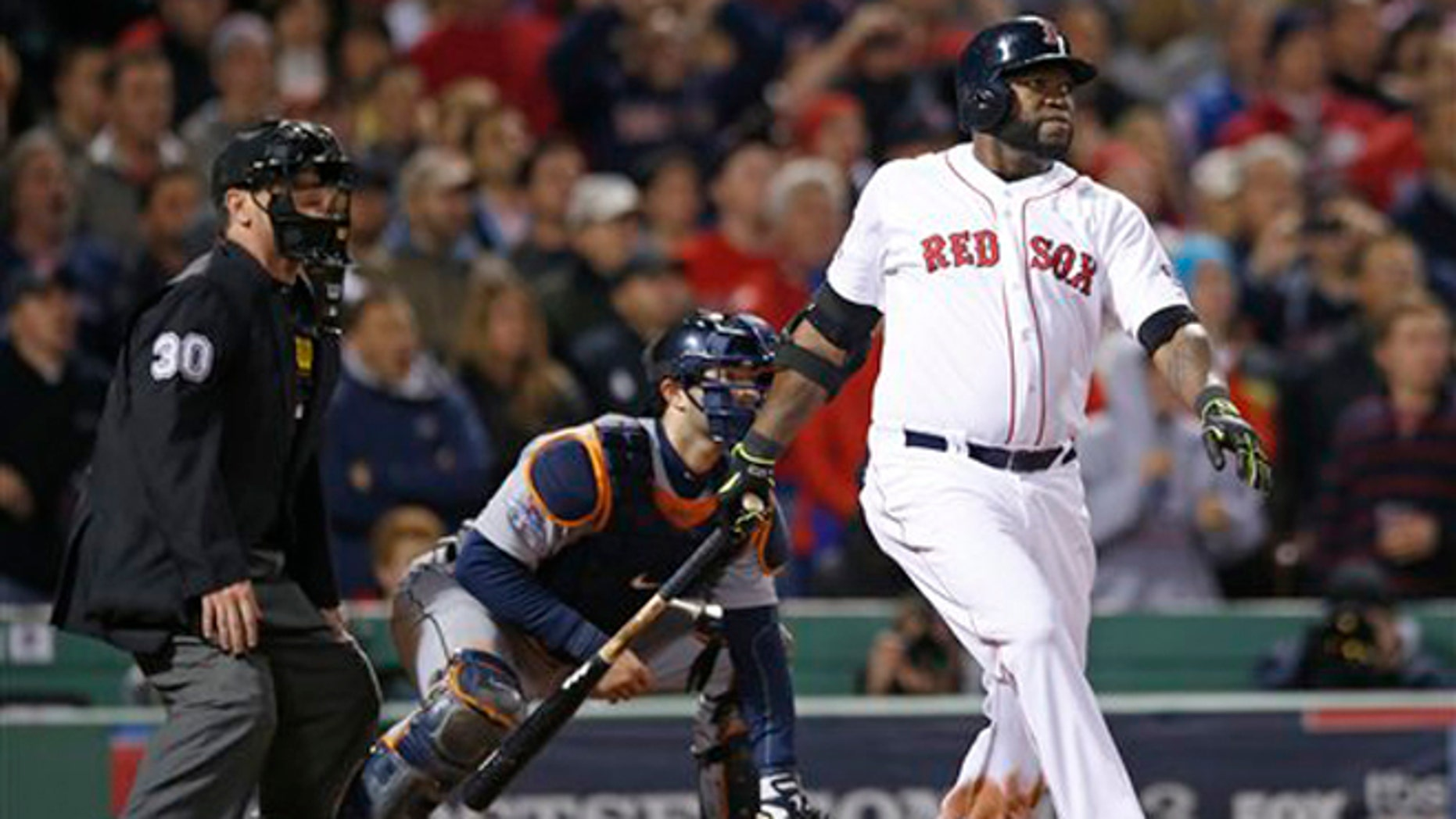 Boston Red Sox's David Ortiz hits a grand slam home run in the eighth inning during Game 2 of the American League baseball championship series against the Detroit Tigers Sunday, Oct. 13, 2013, in Boston. (AP Photo/Elise Amendola)