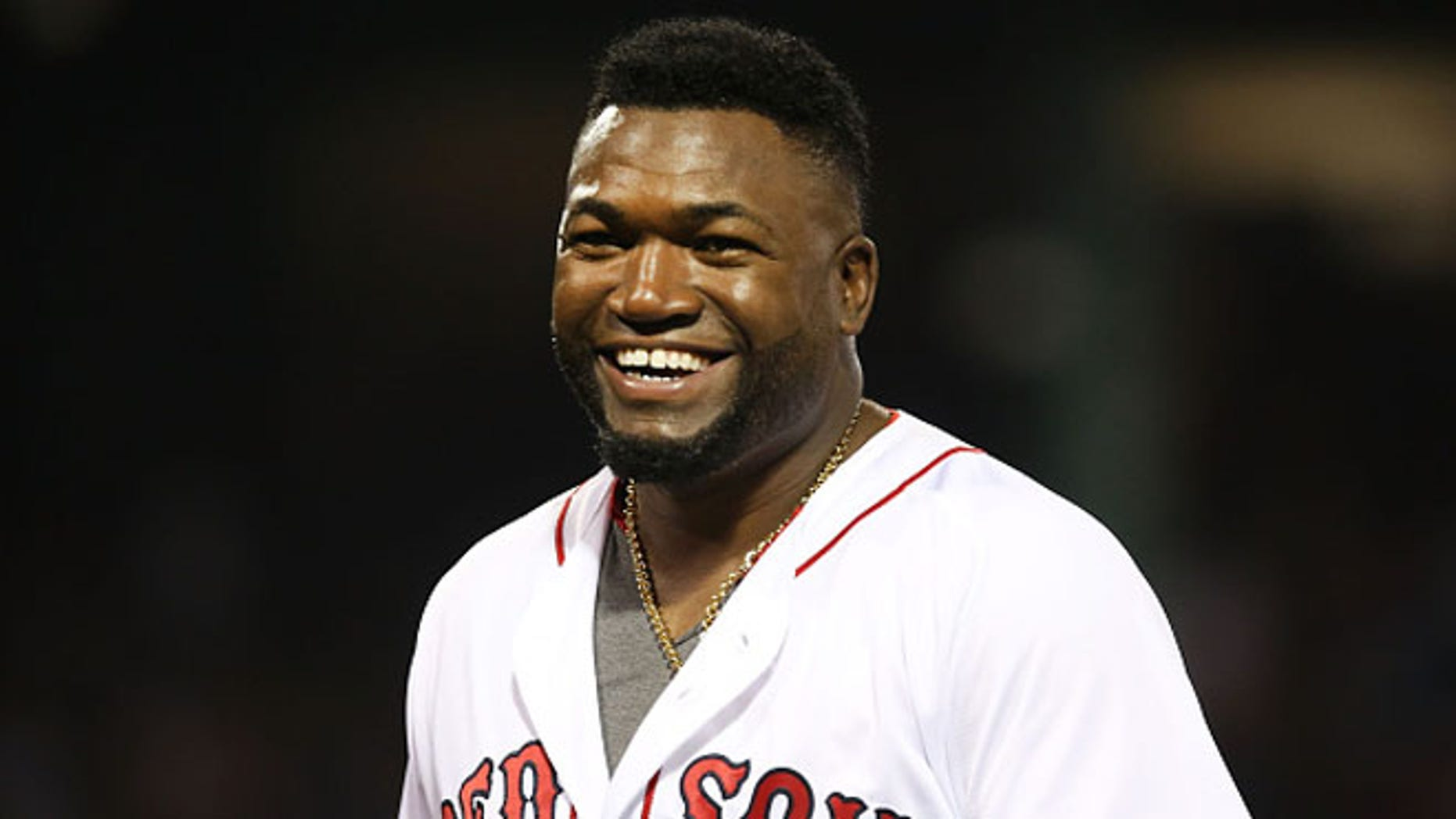 David Ortiz #34 of the Boston Red Sox smiles in the fifth inning during the game against the Texas Rangers at Fenway Park on July 6, 2016 in Boston, Massachusetts.