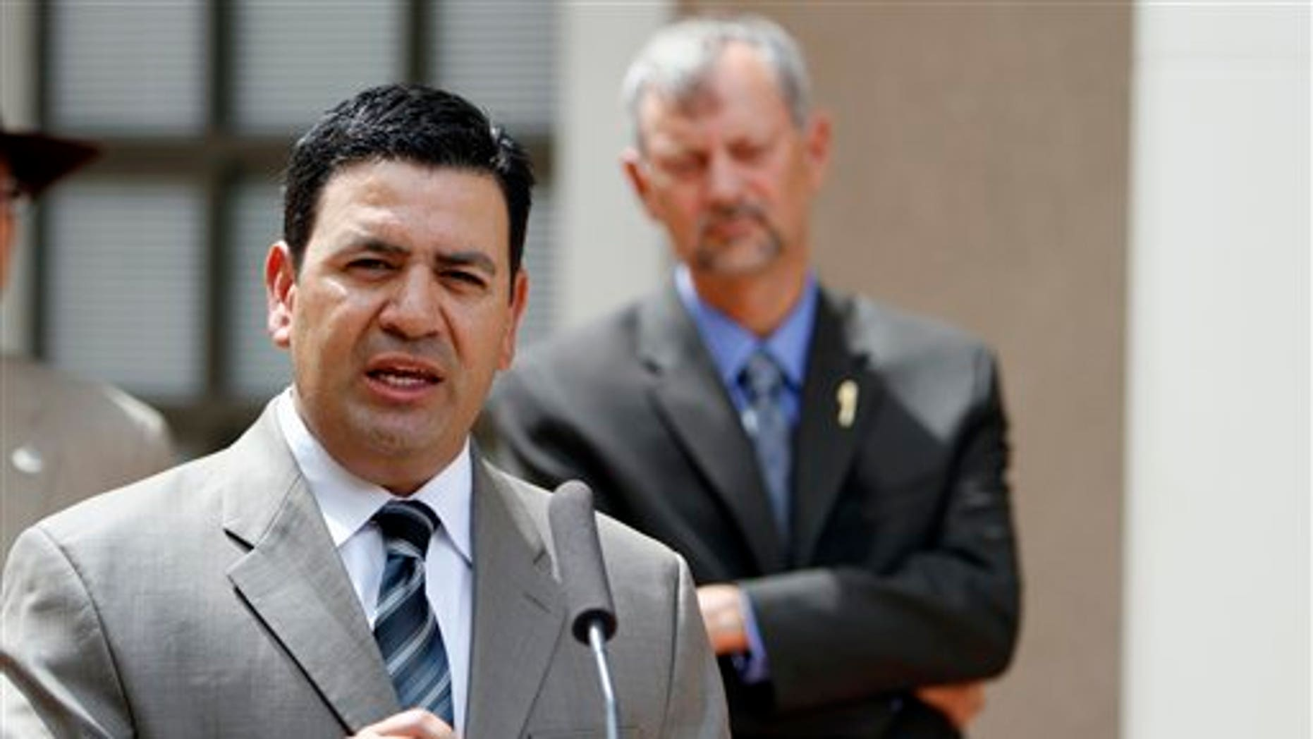 August 24: David Urias, with Freedman Boyd Hollander Goldberg Ives & Duncan law firm, speaks during a news conference outside the State Capitol in Santa Fe, N.M. Four state legislators and a Silver City woman asked a judge Wednesday to stop Gov. Susana Martinez's administration from trying to verify whether immigrants who received a driver's license in New Mexico still live in the state.
