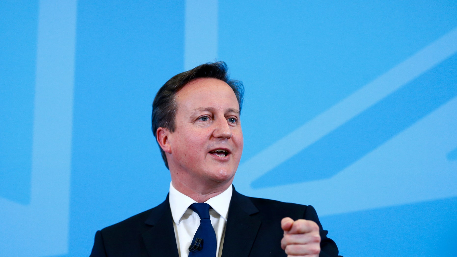 David Cameron speaks on the economy to an audience at a school in Poole, southern England, Dec. 15, 2014.