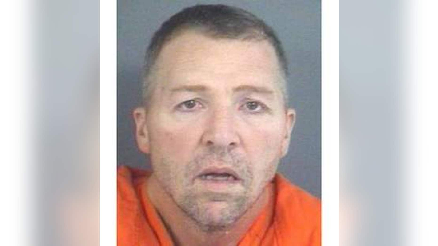 David E. Ison, 46, charged with five counts of murder in Indiana.