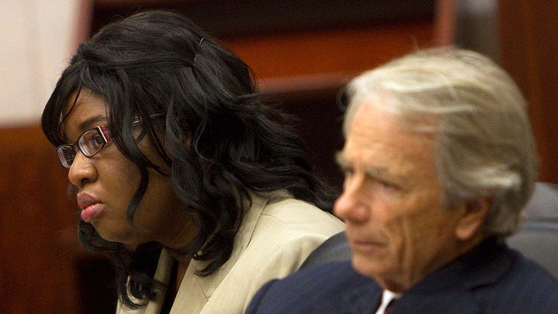 Nov. 12, 2012: In this file photo, home day care operator Jessica Tata, left, and her attorney Mike DeGeurin  listen to the closing arguments in her murder trial for the death of 16-month-old day care fire victim, Elias Castillo, at the Harris County Criminal Justice Center, in Houston.