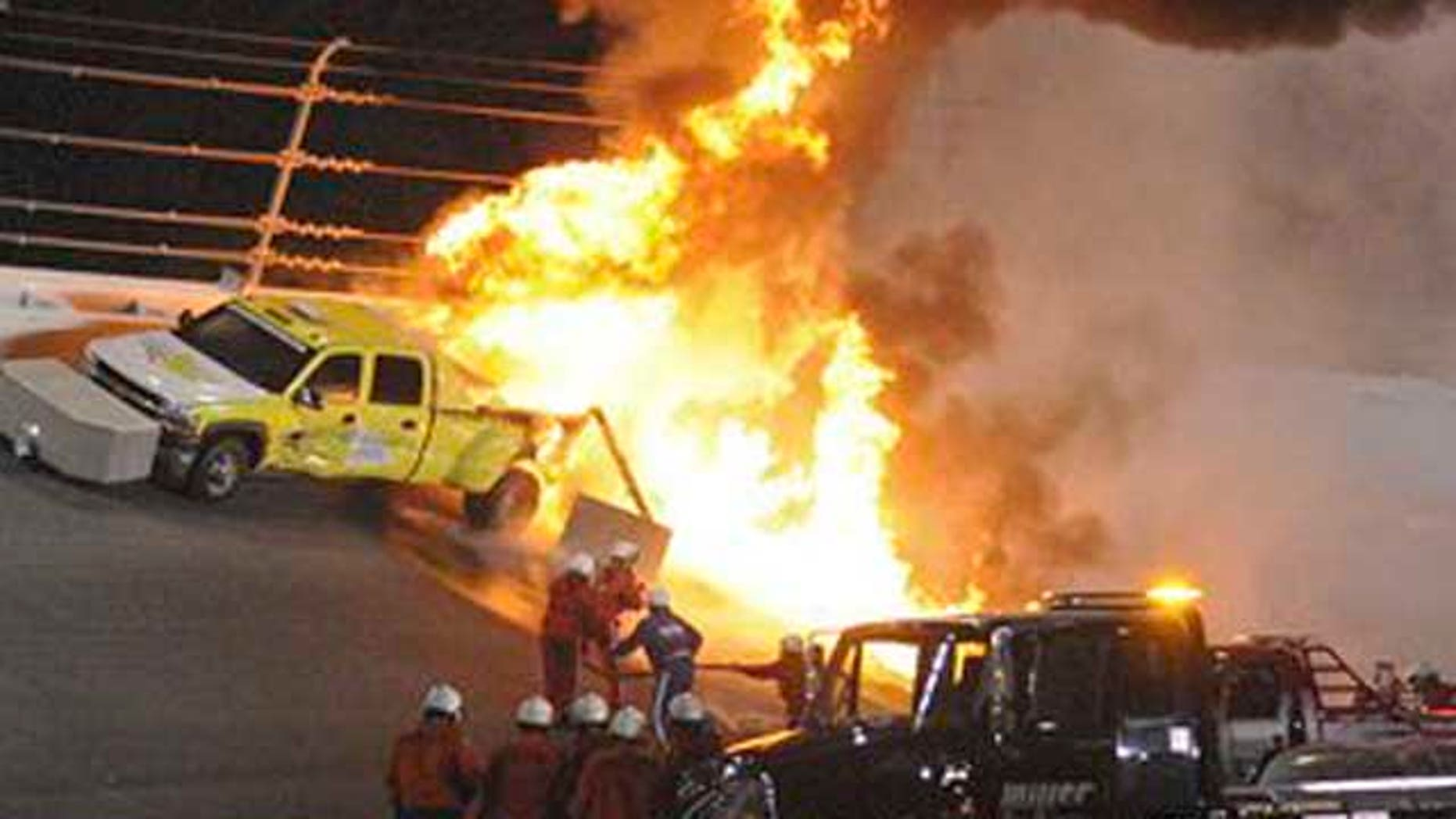 Feb. 27, 2012: Emergency workers try to extinguish a fire on a jet dryer during the NASCAR Daytona 500 auto race at Daytona International Speedway in Daytona Beach, Fla.