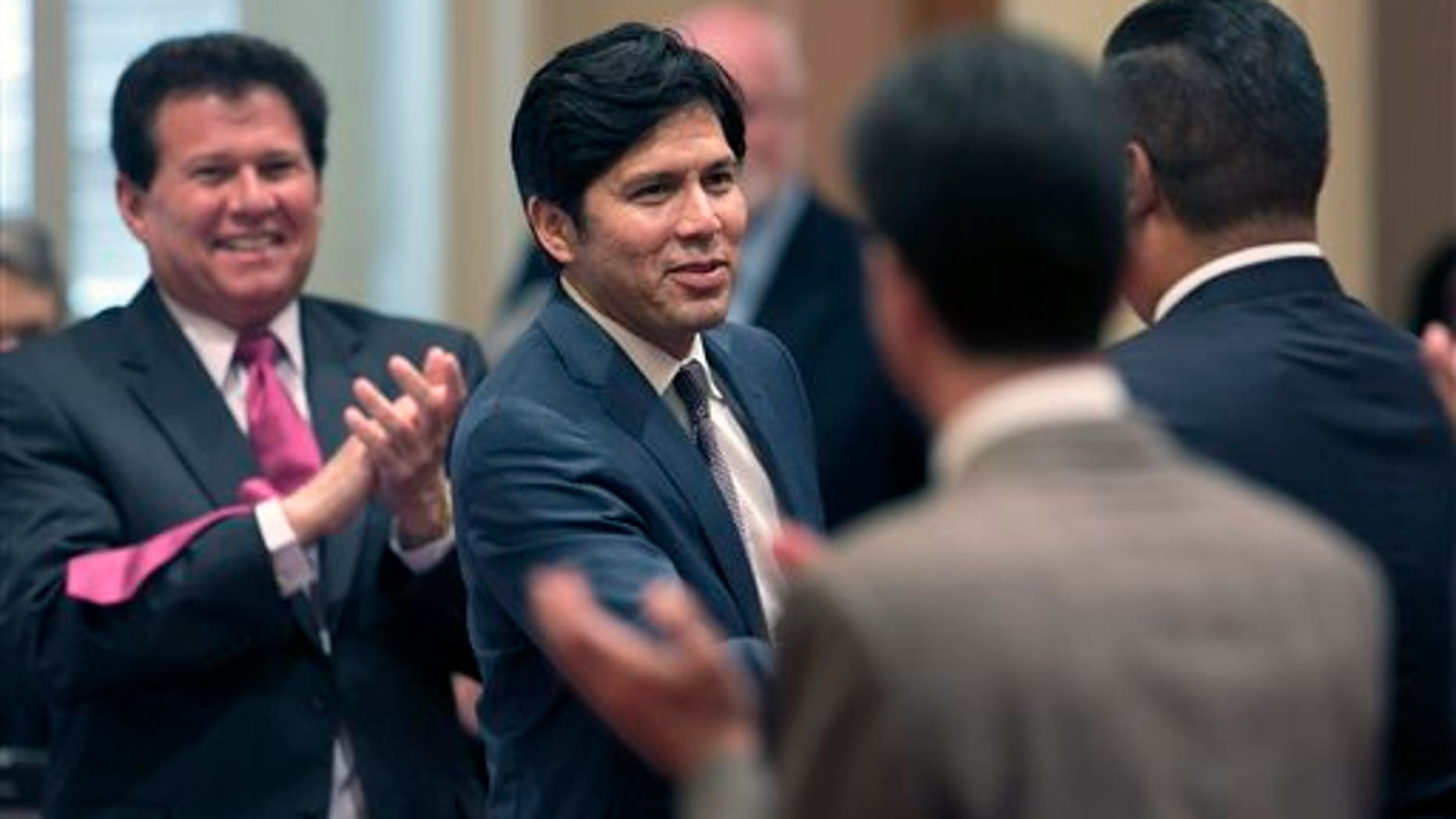 California Senate leader Kevin de Leon shaking hands with lawmakers in 2014.