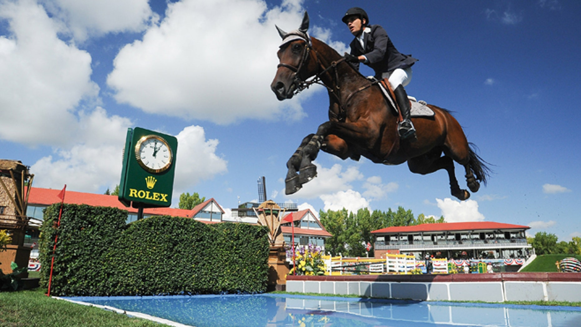 CALGARY, CANADA - SEPTEMBER 08: Andres Rodriguez of Venezuela riding Caballito competes in the individual jumping equestrian on the final day of the Masters tournament at Spruce Meadows on September 8, 2013 in Calgary, Alberta, Canada. Andres placed 18th with a time of 91.49 and 8 faults. (Photo by Derek Leung/Getty Images)