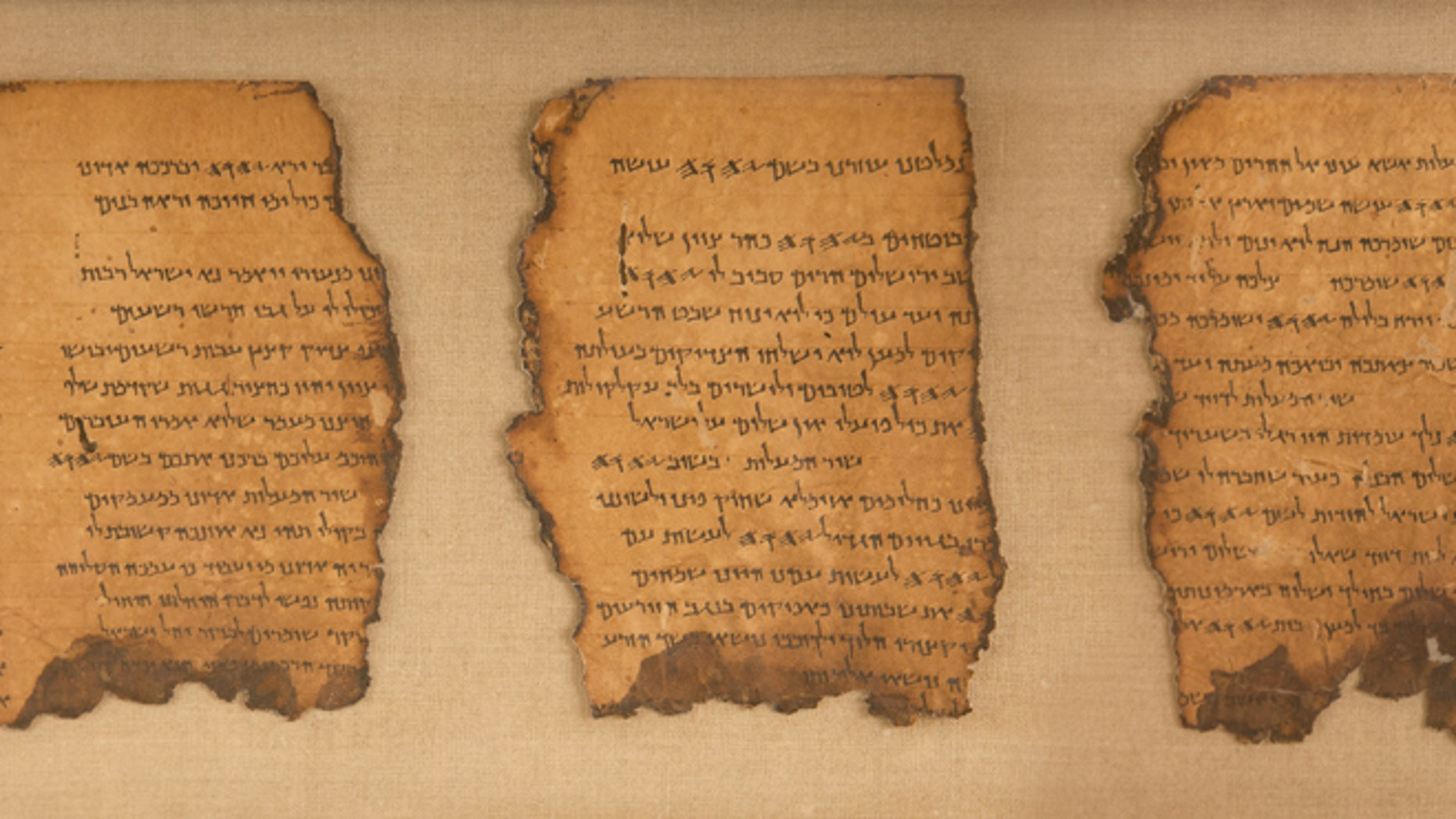 """The ancient Dead Sea Scrolls are on display at the """"Life and Faith In Biblical Times"""" exhibit at  Discovery Times Square in New York City."""