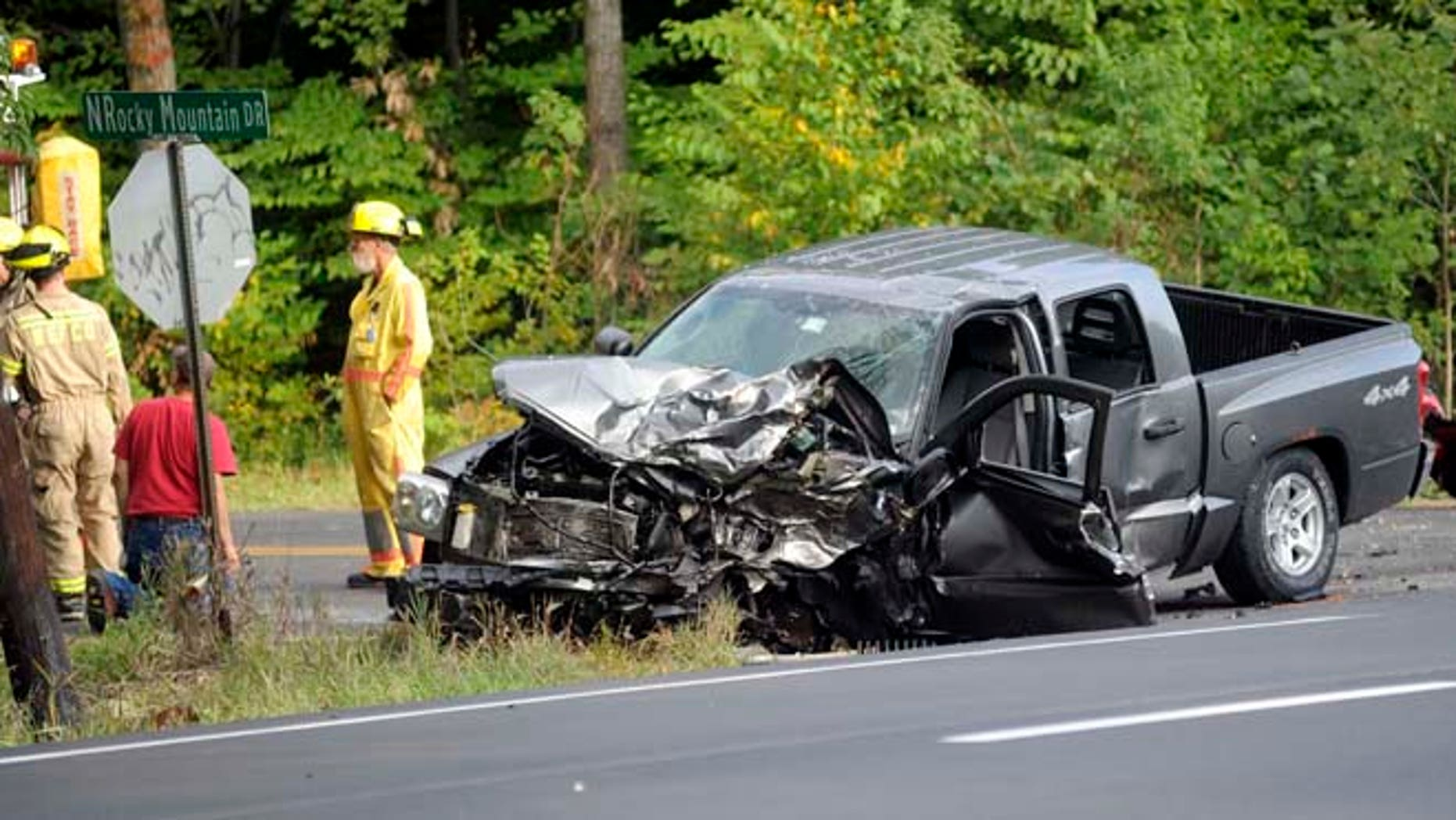 Sept. 20, 2014: Officers stand near the scene of a fatal car accident on Route 115 in Effort, Pa. (AP/Pocono Record, Keith R. Stevenson)