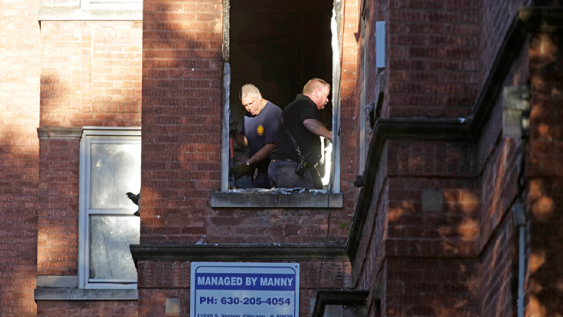 Sept. 8, 2014: Fire marshals sift through debris in an apartment building where four children died in an early morning fire in Chicago. (AP)