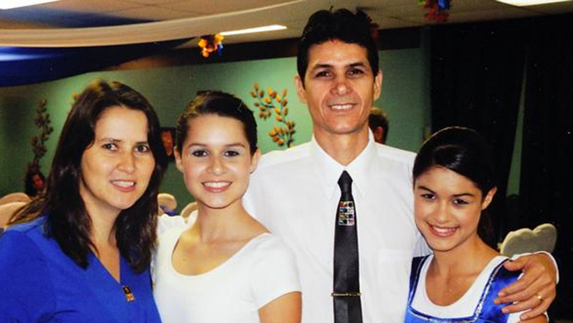 The Carmo family, Adriana, Leticia, 17, Jose Jr. and Lidiane, 15, pose at the church in Marietta, Ga. Florida Highway Patrol spokesman Lt. Patrick Riordan confirmed Jose Carmo Jr., Adriana Carmo, Leticia Carmo and Edson Carmo, not shown in picture, as victims in the Sunday crash in Florida that killed 10 people.