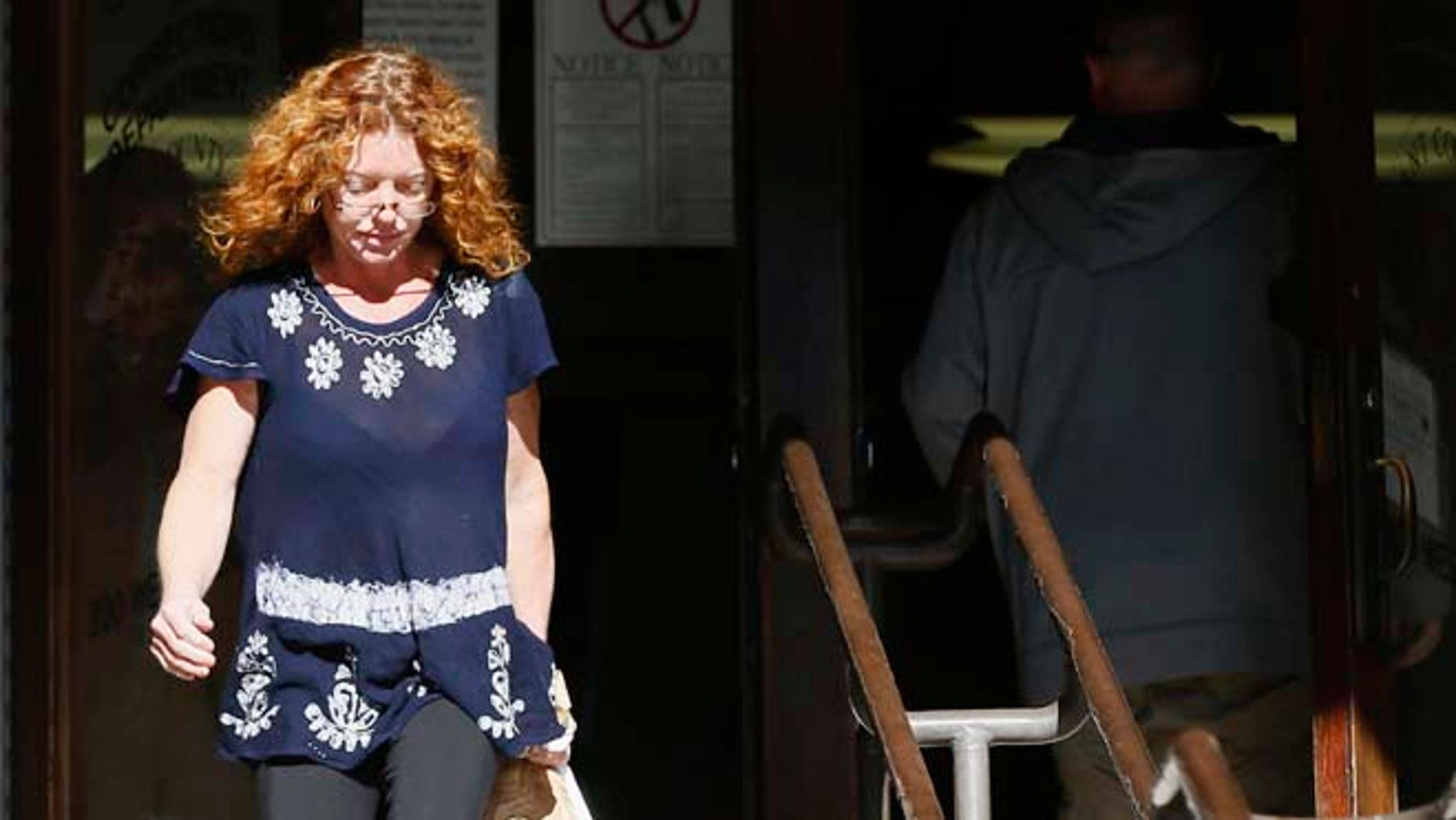 """Wearing a GPS monitor on her left ankle, Tonya Couch, the mother of a Texas teen who used an """"affluenza"""" defense in a drunken wreck, leaves Tarrant County Community Supervision and Corrections Department on Tuesday, Jan. 12, 2016, in Fort Worth, Texas. A judge decreased Couch's bond Monday from $1 million to $75,000. Couch is charged with hindering the apprehension of a felon after she and her son, Ethan Couch, were caught in a Mexican resort city. (AP Photo/Brandon Wade)"""
