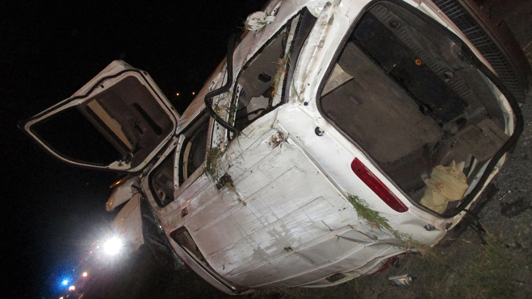 In this photo provided by the Edna Police Department, an SUV that flipped several times remains on the scene following a fatal crash and police chase Thursday, Sept. 24, 2015, in Edna, Texas. Officers tried to stop the SUV for a traffic violation but the vehicle sped away and police gave chase. (Edna Police Department via AP) MANDATORY CREDIT