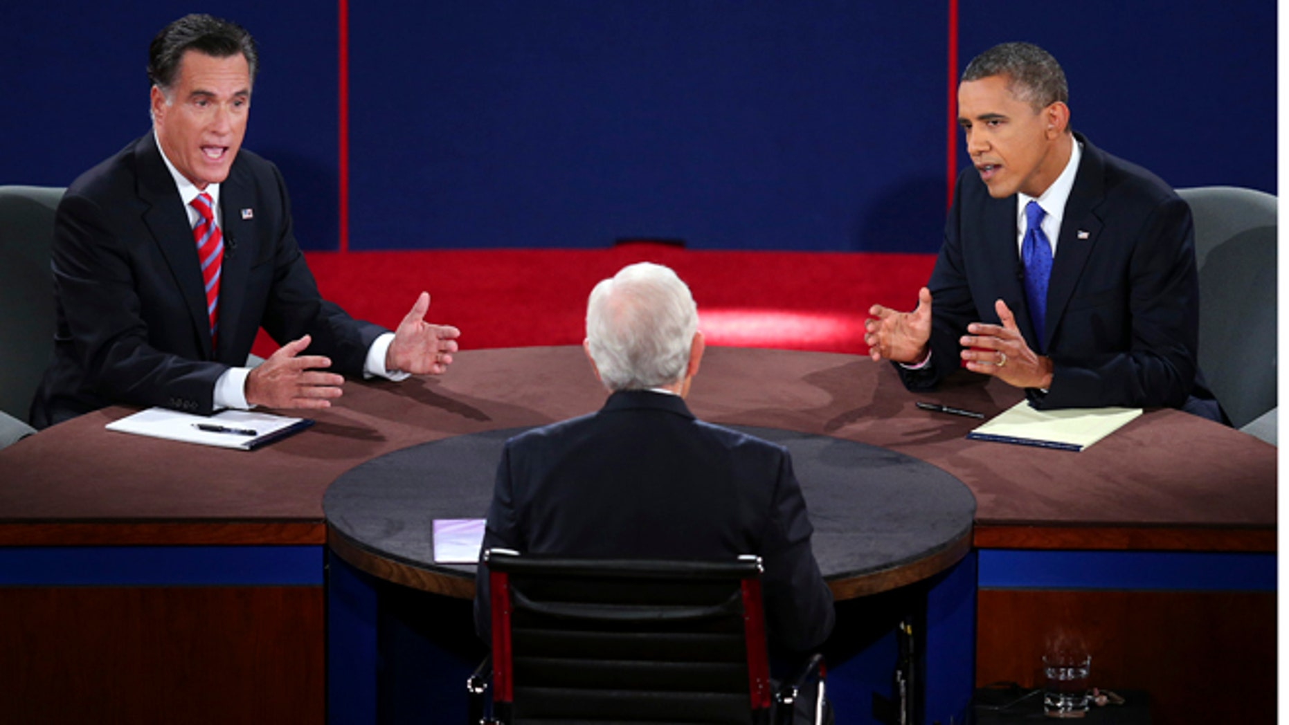 Oct. 22, 2012: Republican presidential nominee Mitt Romney and President Barack Obama answer a question during the third presidential debate at Lynn University, in Boca Raton, Fla.
