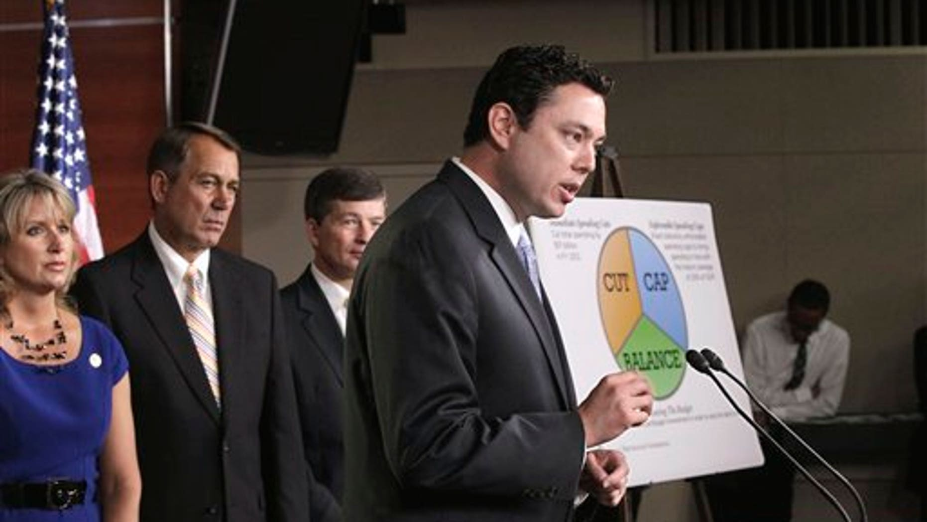 "July 19: Budget Committee member Rep. Jason Chaffetz, R-Utah, right, talks about his ""cut, cap and balance"" plan proposed by tea party-backed House Republicans, during a news conference on Capitol Hill in Washington. From left are, Rep. Renee Ellmers, R-N.C., House Speaker John Boehner of Ohio,, Republican Conference Chairman Rep. Jeb Hensarling, R-Texas, and Chaffetz."