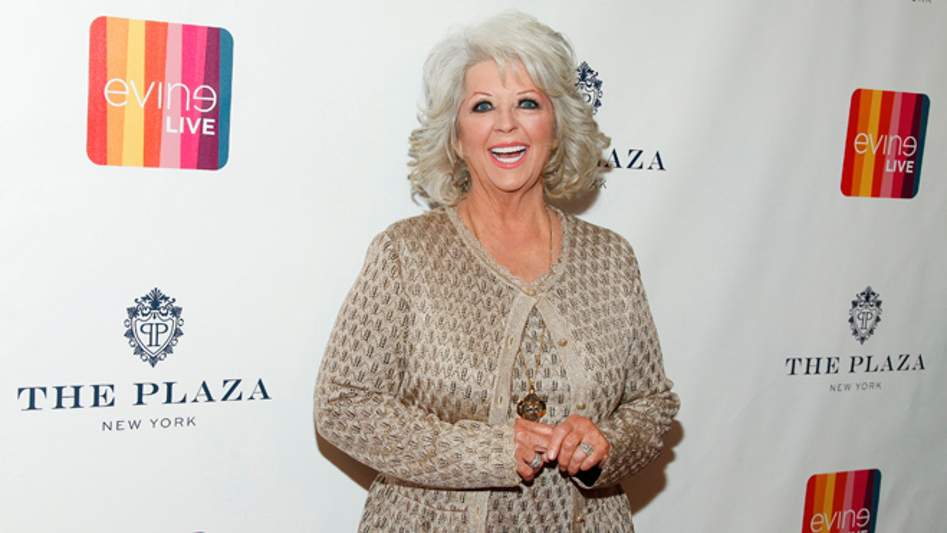 "FILE - In this Feb. 13, 2015 file photo, Paula Deen attends the EVINE Live launch event at The Todd English Food Hall at The Plaza in New York. A spokesman for Deen says she didn't post a 2011 Halloween costume photo on her Twitter account showing her son Bobby in dark makeup as ""I Love Lucy"" character Ricky Ricardo. Deen spokesman Jaret Keller said Tuesday, July 7, 2015, that a social media manager posted the photo taken in connection with Deen's former Food Network show.   (Photo by Andy Kropa/Invision/AP, File)"