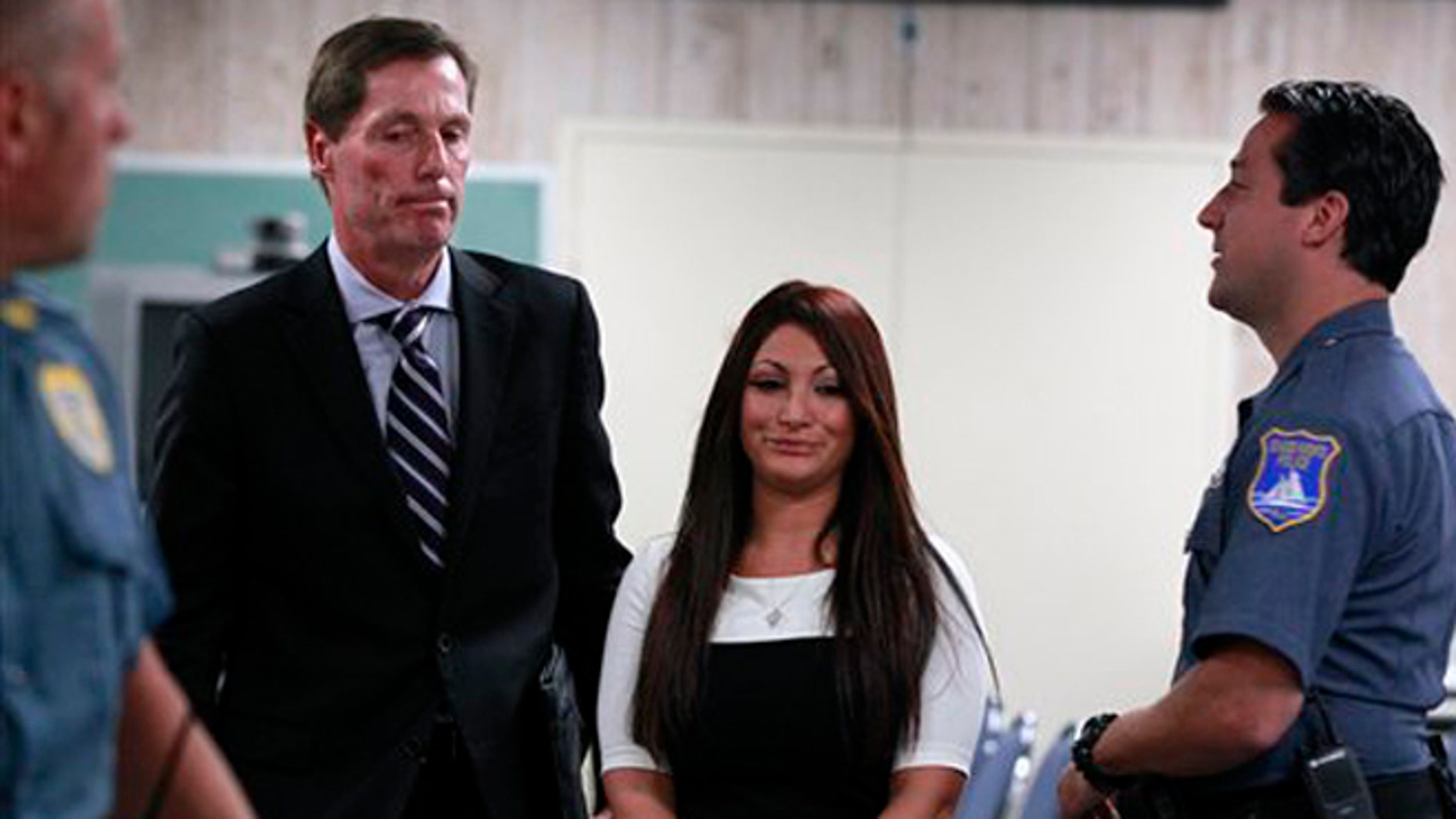 """July 3, 2012: """"Jersey Shore"""" cast member Deena Cortese, center, walks with her attorney Michael Pappa, left, in court after a hearing in Seaside Heights, N.J."""