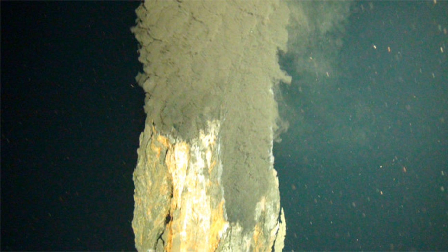 First photograph of the world's deepest known 'black smoker' vent, erupting water hot enough to melt lead, 3.1 miles deep on the ocean floor in the Caribbean.