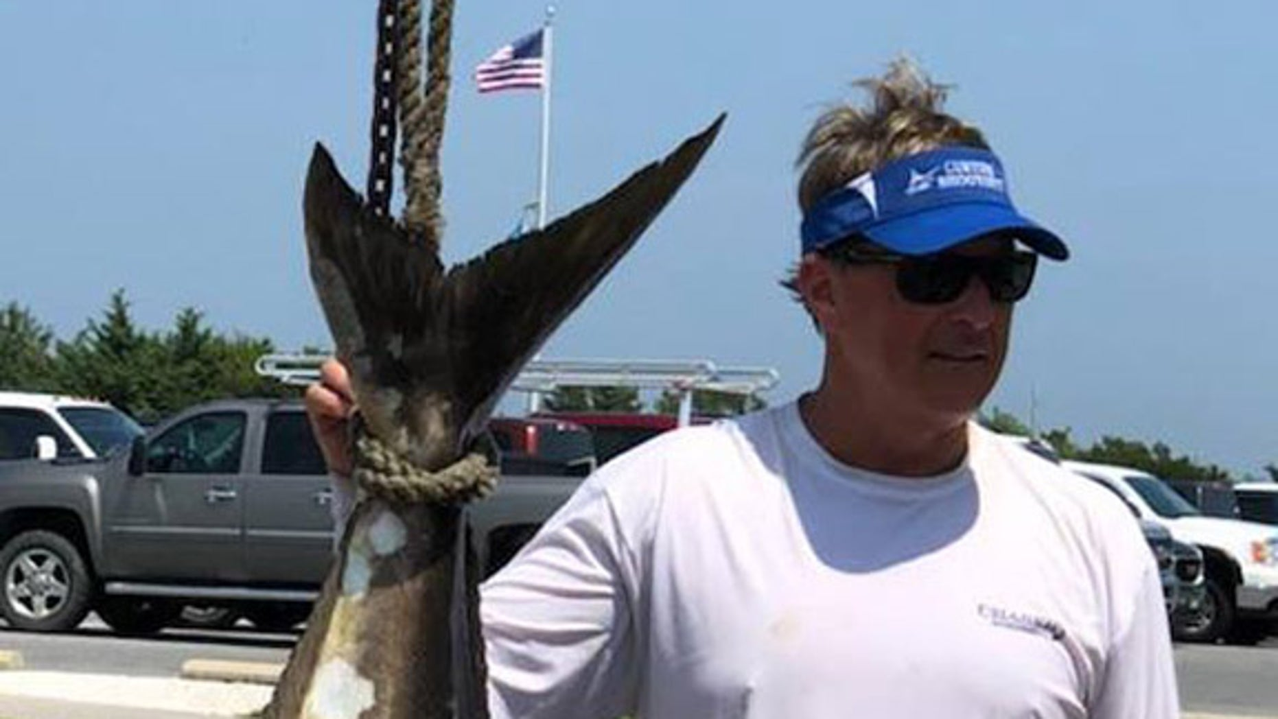 John Burbage, of Ocean View, wrestled with his massive catch for over an hour before reeling it in.