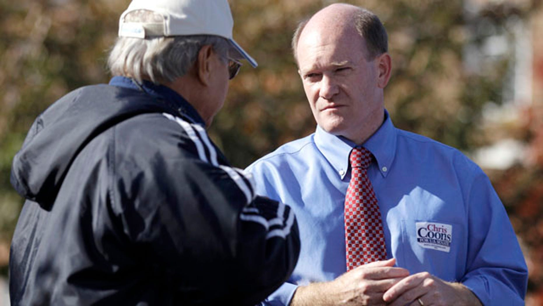 Nov. 2: Delaware Democratic Senate candidate Chris Coons, right, talks with Venerando Maximo, outside a polling station in Dover, Del.