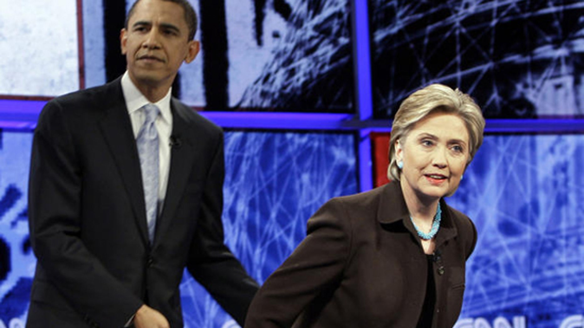 FILE: Sen. Barack Obama first pledged opening up legislative negotiations to C-SPAN cameras during a Democratic presidential primary debate with Sen. Hillary Clinton in Los Angeles on Jan. 31, 2008. In this photo, Obama helps Clinton to her seat before the start of that debate. (AP Photo)