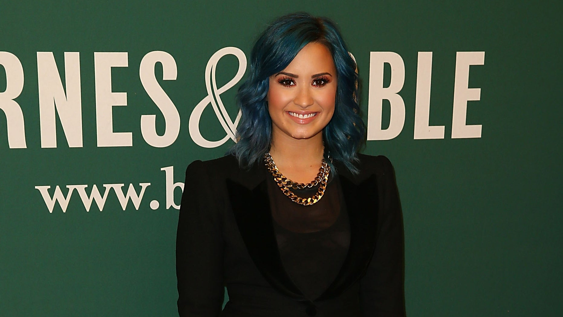 LOS ANGELES, CA - NOVEMBER 23:  Demi Lovato arrives to a book signing at Barnes & Noble bookstore at The Grove on November 23, 2013 in Los Angeles, California.  (Photo by Joe Scarnici/Getty Images)
