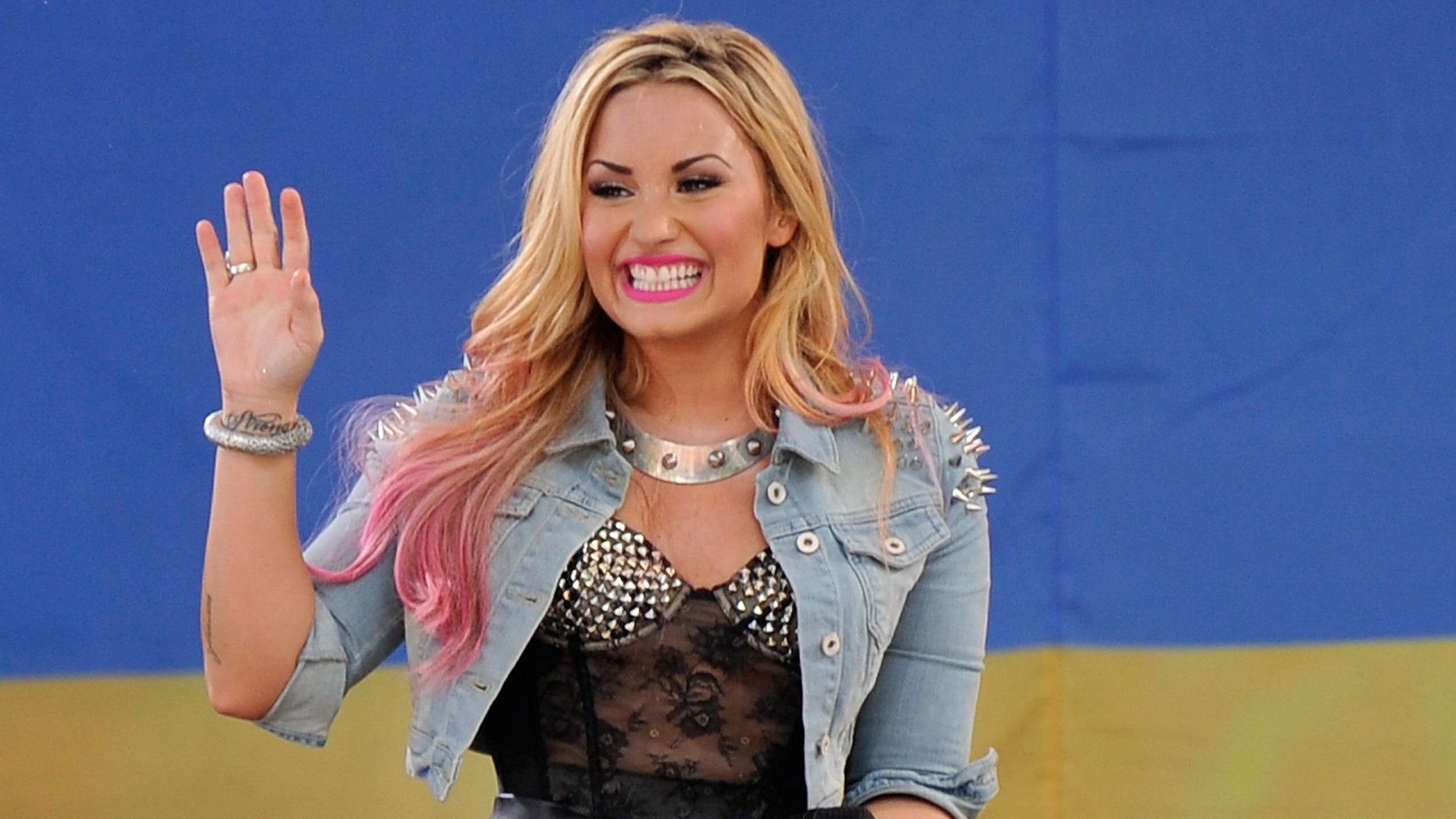 """NEW YORK, NY - JULY 06:  Singer Demi Lovato performs on ABC's """"Good Morning America"""" at Rumsey Playfield, Central Park on July 6, 2012 in New York City.  (Photo by Stephen Lovekin/Getty Images)"""