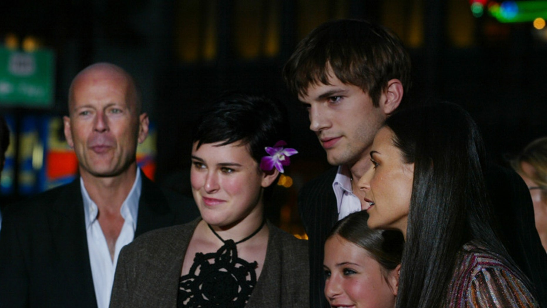 """Actress Demi Moore,(R) one of the stars of the new film """"Charlie's AngelsFull Throttle"""" arrives with actor Ashton Kutcher (C) and her daughters (L-R)Rumer Glenn Willis, Scout LaRue Willis and Tallulah Belle Willis, along withher ex-husband, actor Bruce Willis (Far L) for the film's premiere inHollywood June 18, 2003. Moore and Kutcher have reportedly been dating. Thefilm stars Lucy Liu, Drew Barrymore and Cameron Diaz and opens June 27 inthe United States.      PP03060056         Pictures of the Year 2003REUTERS/Fred ProuserFSP"""