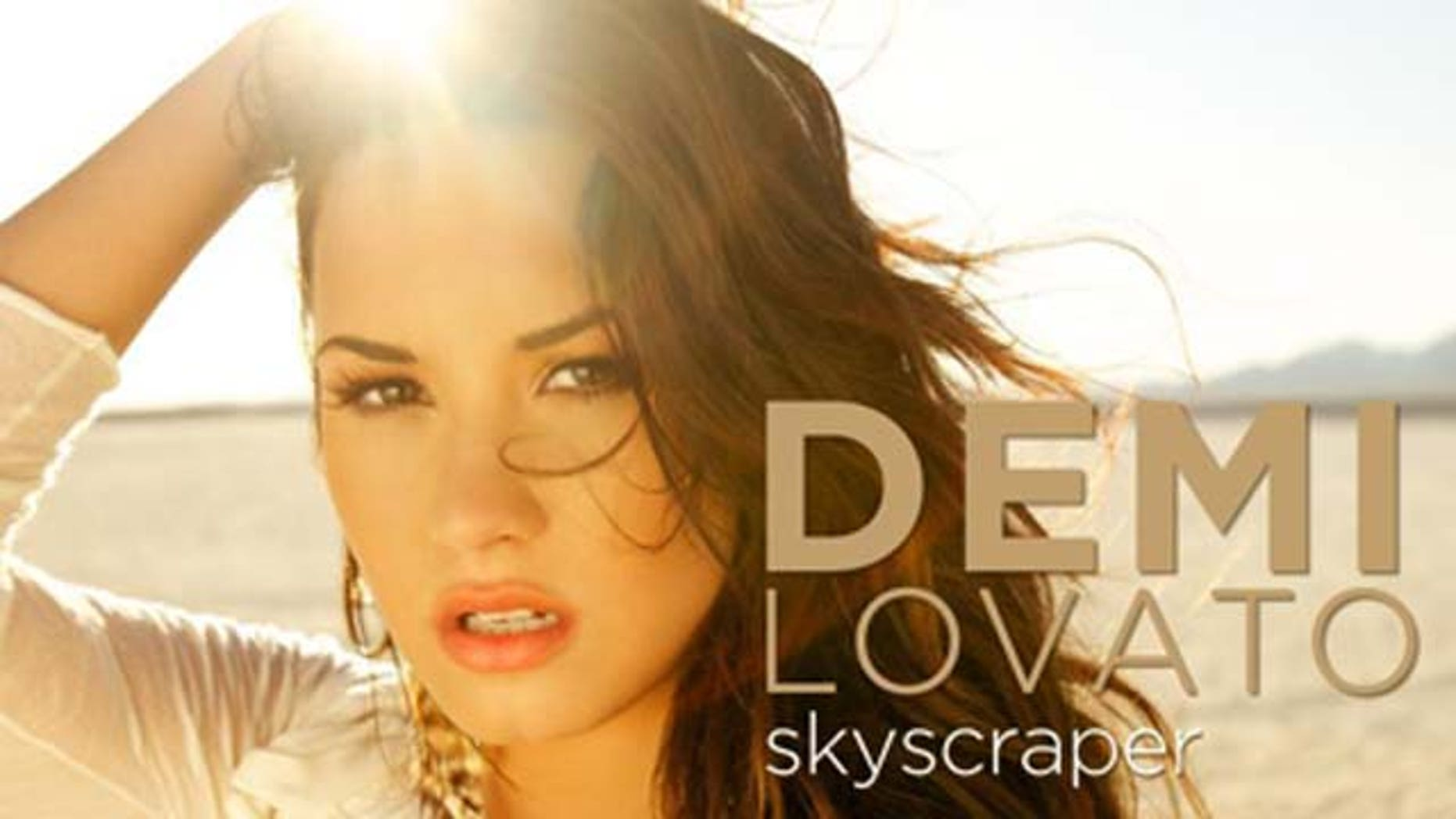 "July 4, 2011: Demi Lovato released the cover for her new single ""Skyscraper"" available digitally July 14, 2011."