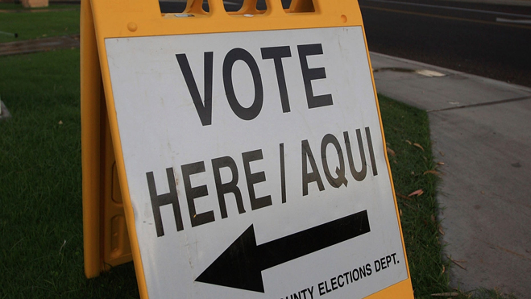 PHOENIX - NOVEMBER 4:  A bilingual sign announces a polling place in the home state of Republican presidential nominee U.S. Sen. John McCain (R-AZ) November 4, 2008 in Phoenix, Arizona. Voting is underway in the U.S. presidential elections with Democratic presidential nominee Sen. Barack Obama (D-IL) leading in the polls against the Republican presidential nominee Sen. John McCain (R-AZ).  (Photo by David McNew/Getty Images)