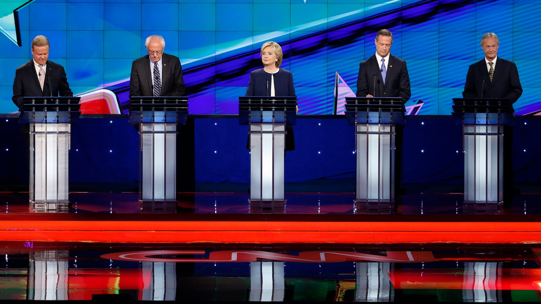 Democratic presidential candidates take the stage before the CNN debate Tuesday, Oct. 13, 2015, in Las Vegas.