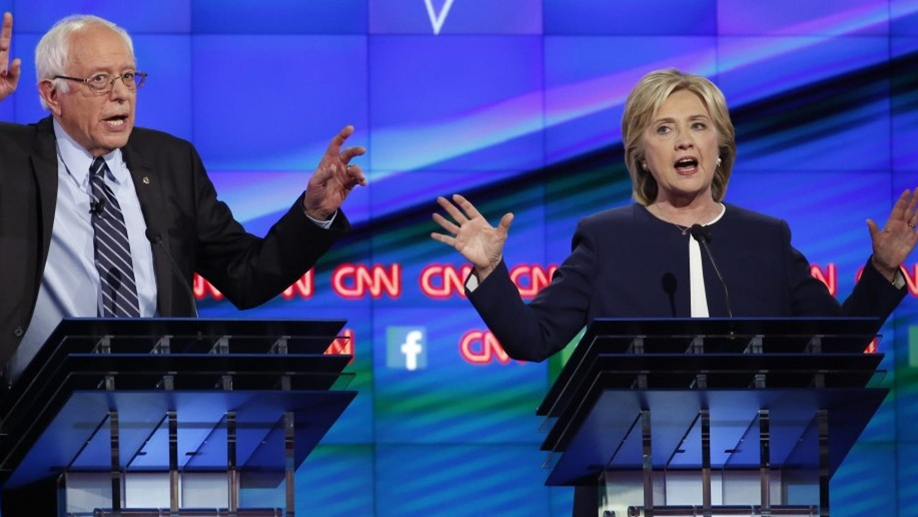 Democratic presidential candidates Sen. Bernie Sanders and former Secretary of State Hillary Clinton debate during the first official Democratic candidates debate of the 2016 presidential campaign in Las Vegas, Oct. 13, 2015. (REUTERS/Lucy Nicholson)