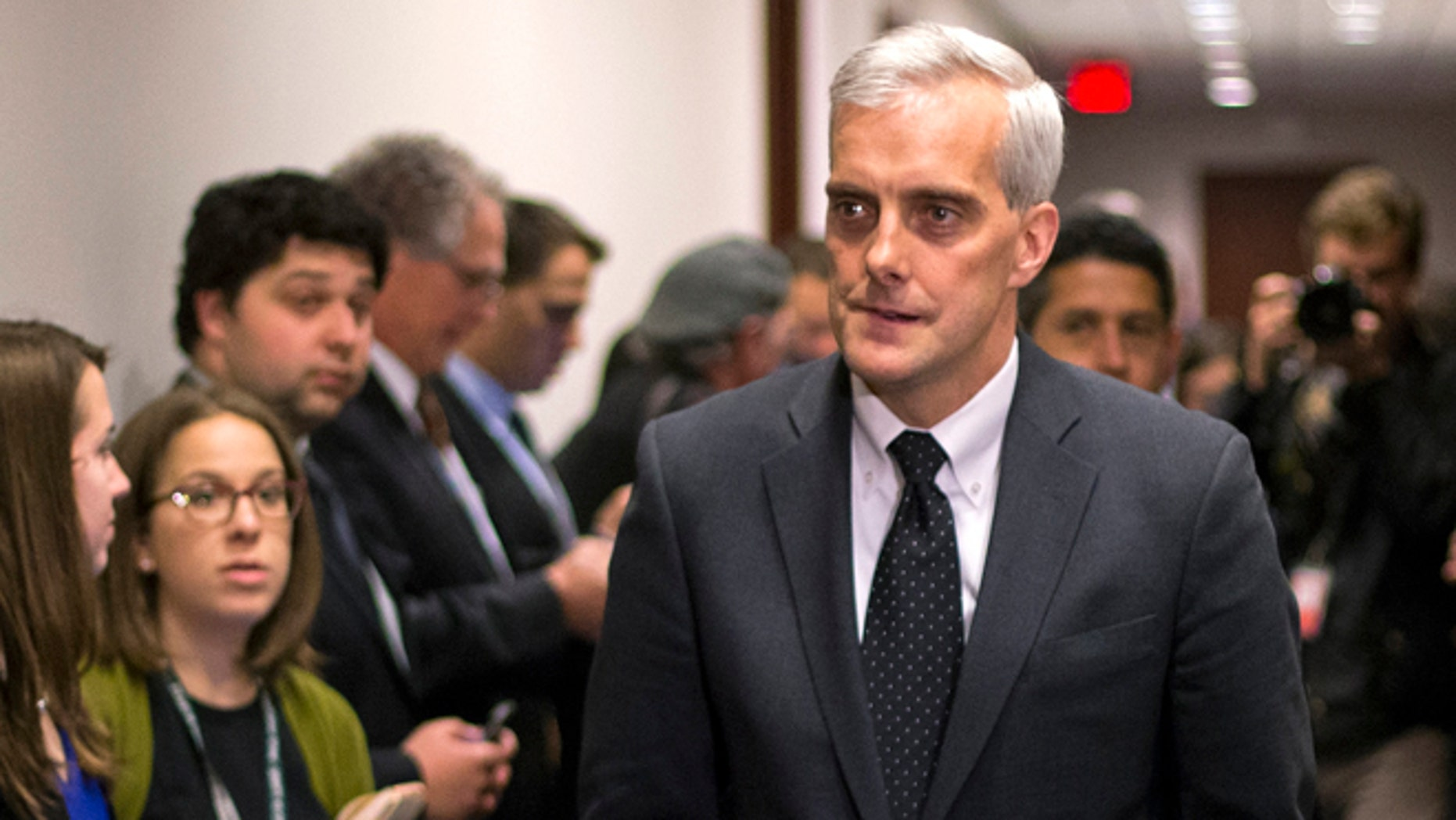In this Dec. 11, 2014 file photo, White House Chief of Staff Denis McDonough arrives to attend a U.S. House Democratic Caucus meeting at the US Capitol in Washington.
