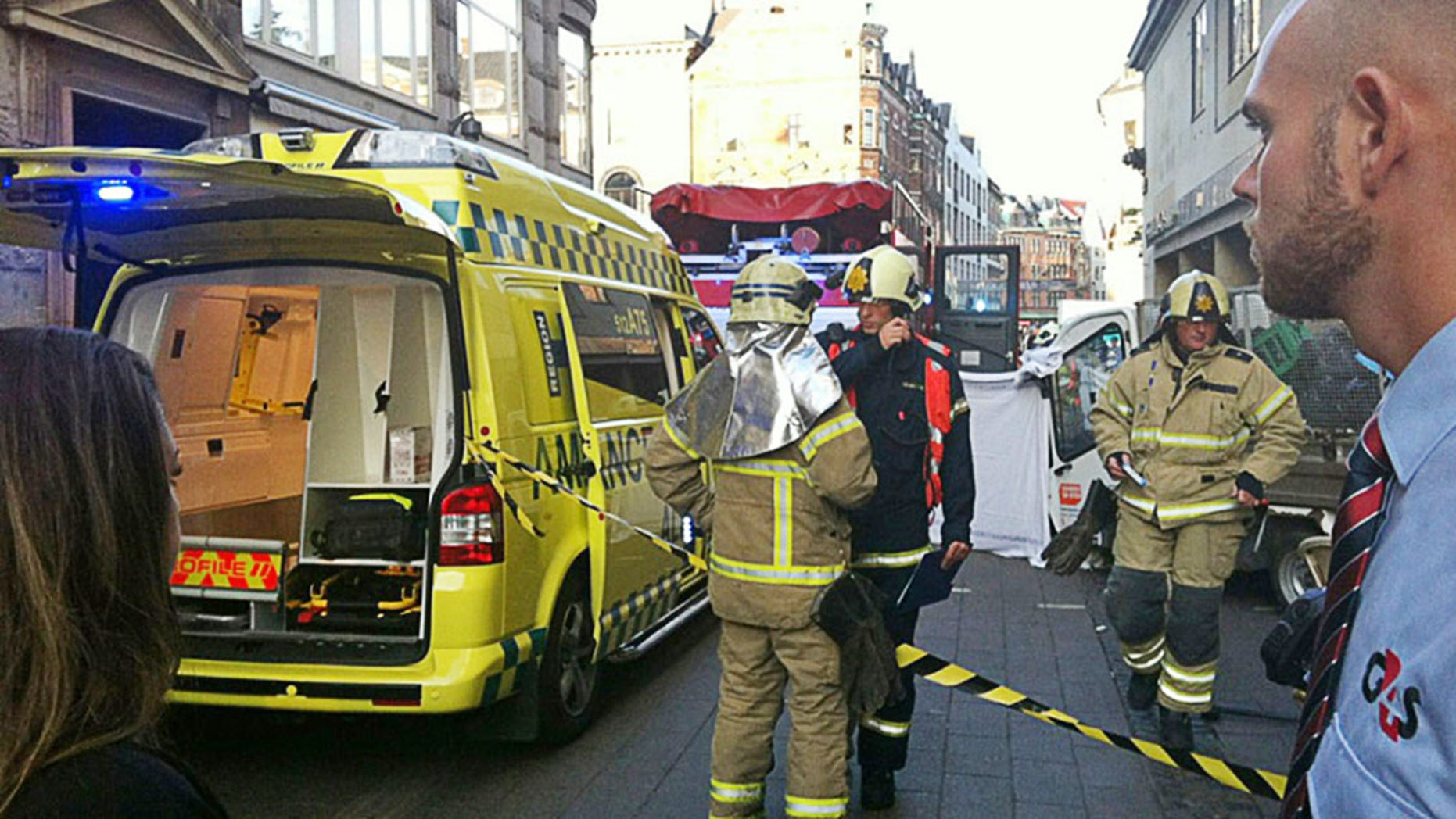 Firemen at the scene after a garbage truck went out of control and killed an American tourist and wounded several others in an incident on Copenhagen's pedestrian street Stroeget, Wednesday, Aug. 29, 2012. (AP Photo / Camilla Cornelius/POLFOTO) DENMARK OUT