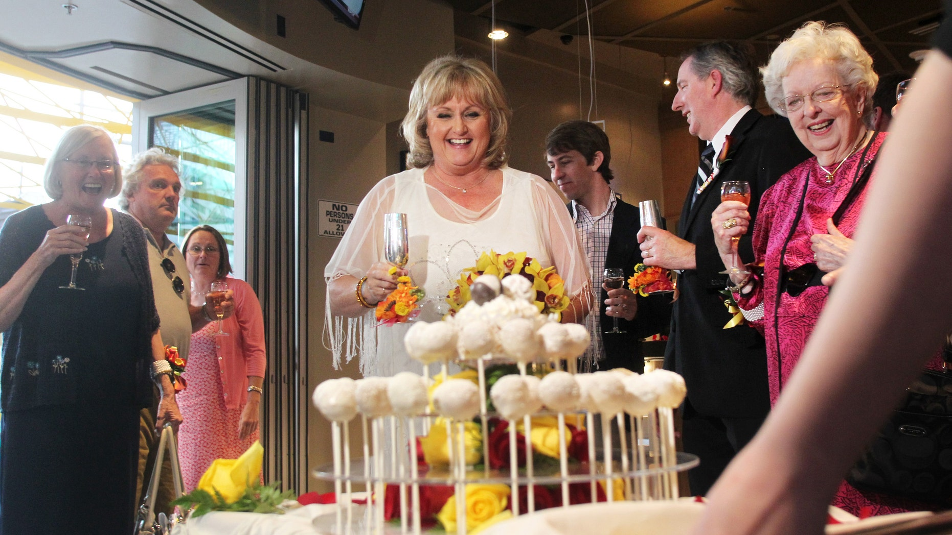 Nancy Levindowski reacts as her wedding cake is wheeled out after exchanging vows with Steve Keller at the Denny's restaurant.