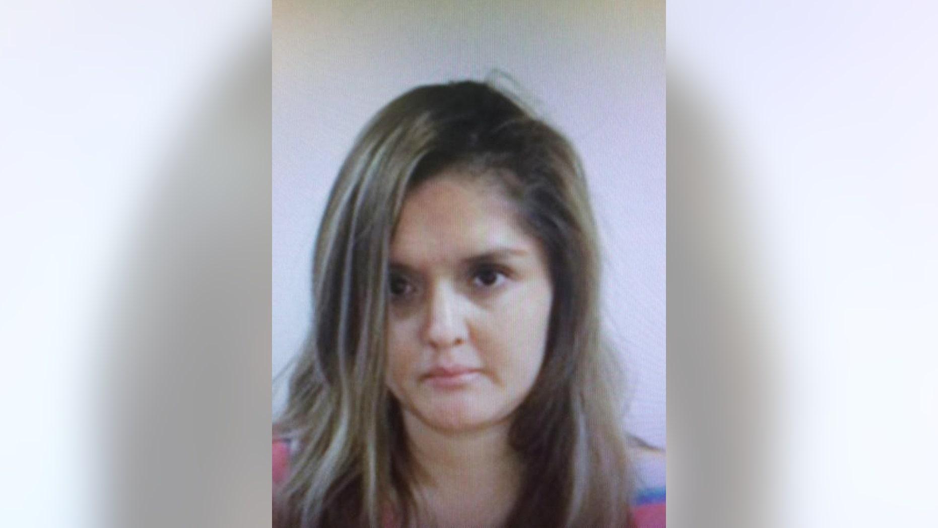 Undated handout photo of Brenda Delgado provided by the FBI.
