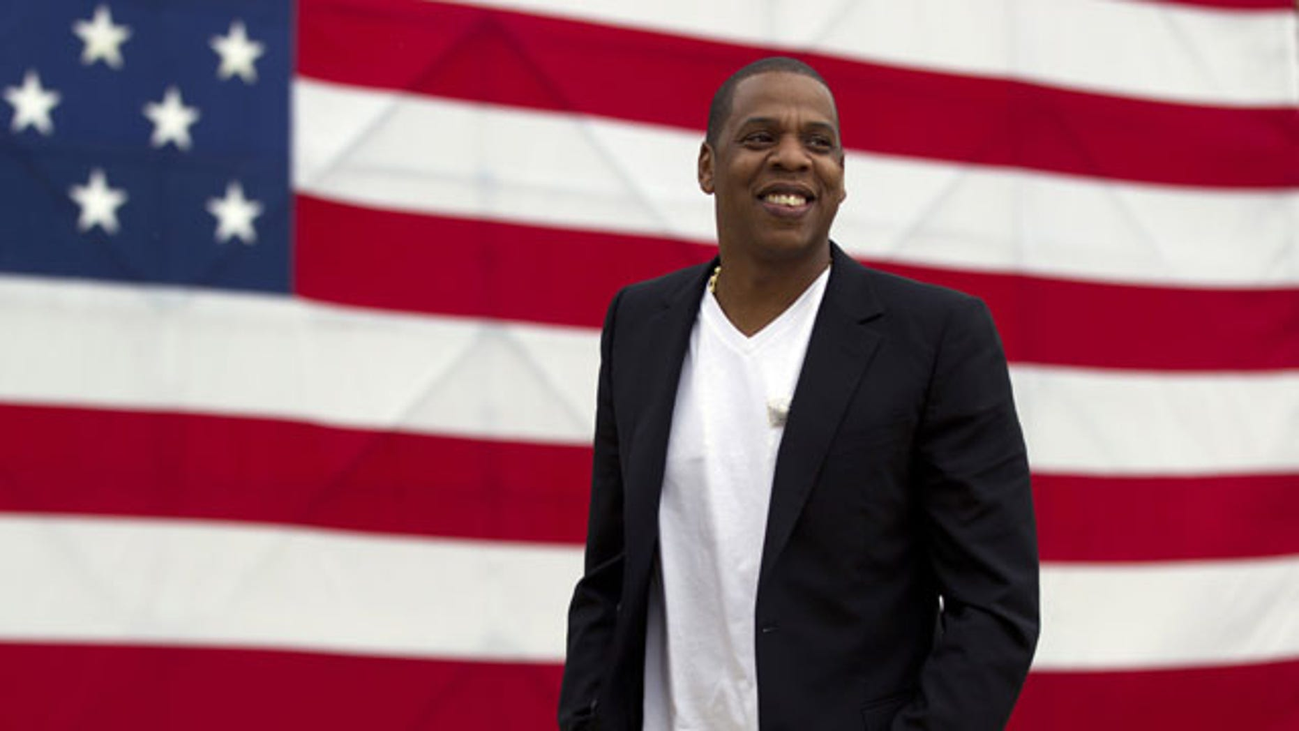 "FILE- In this May 14, 2012 file photo, entertainer Shawn ""Jay-Z"" Carter arrives at the Philadelphia Museum of Art. The rap mogul is taking some heat over his relationship with the luxury store Barneys New York, amid allegations the store racially profiled two customers. Jay-Z plans to partner with the store for an upcoming holiday collection of items. (AP Photo/Matt Rourke, File)"