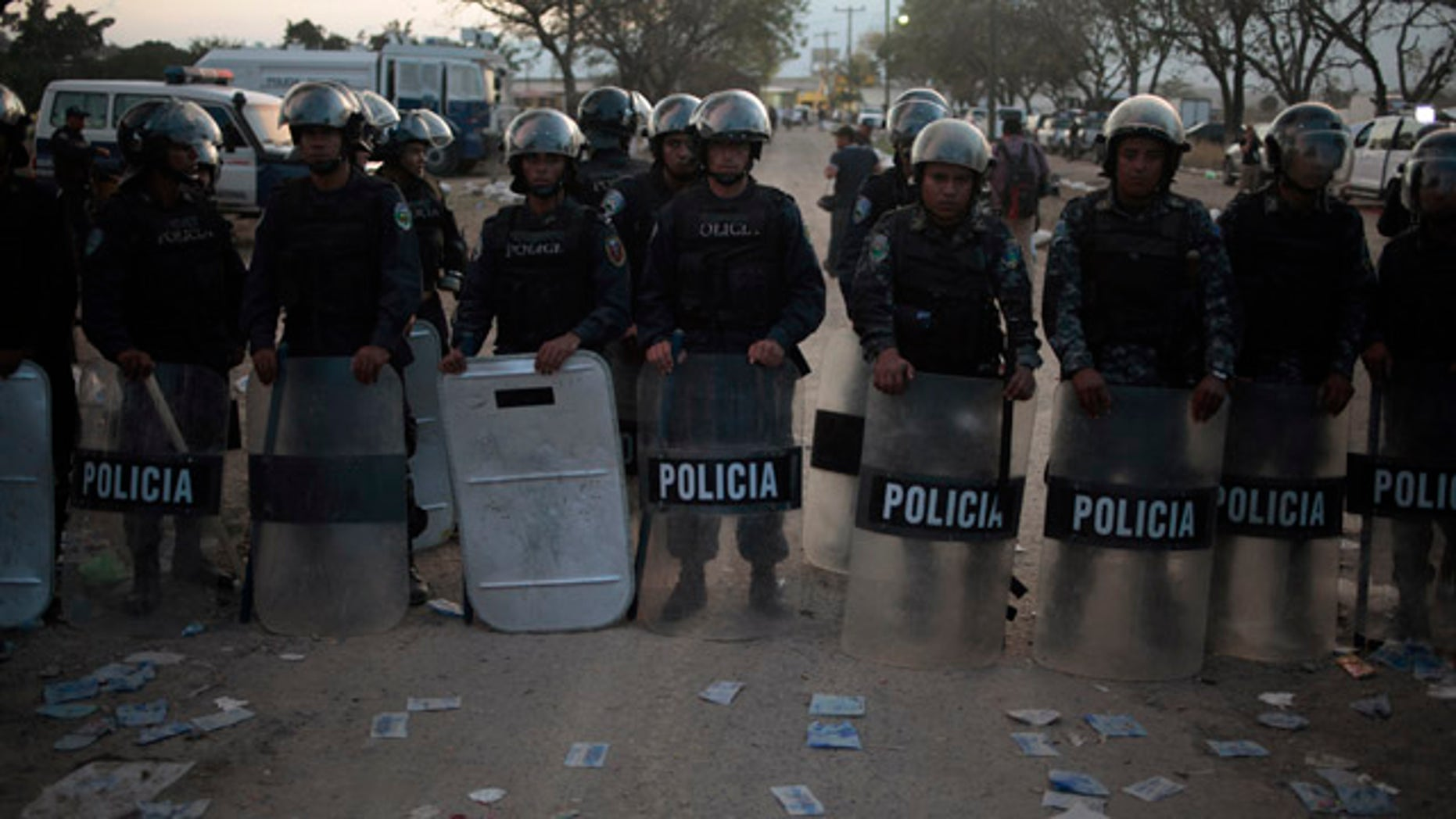 Feb. 15: Policemen stand guard outside a jail in Comayagua, about 45 miles north of the capital Tegucigalpa.