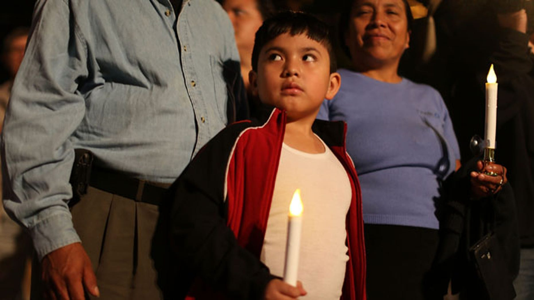 HOMESTEAD, FL - JANUARY 06:  Rodrigo Hernandez, whose family is originally from Guatemala, attends a vigil with his family to protest against the deportation of undocumented immigrants on January 6, 2016 in Homestead, Florida. President Barack Obama's administration has begun a series of large-scale raids against hundreds of undocumented immigrants across the US, which is generating outrage among pro-immigrant groups who reject the measure.  (Photo by Joe Raedle/Getty Images)